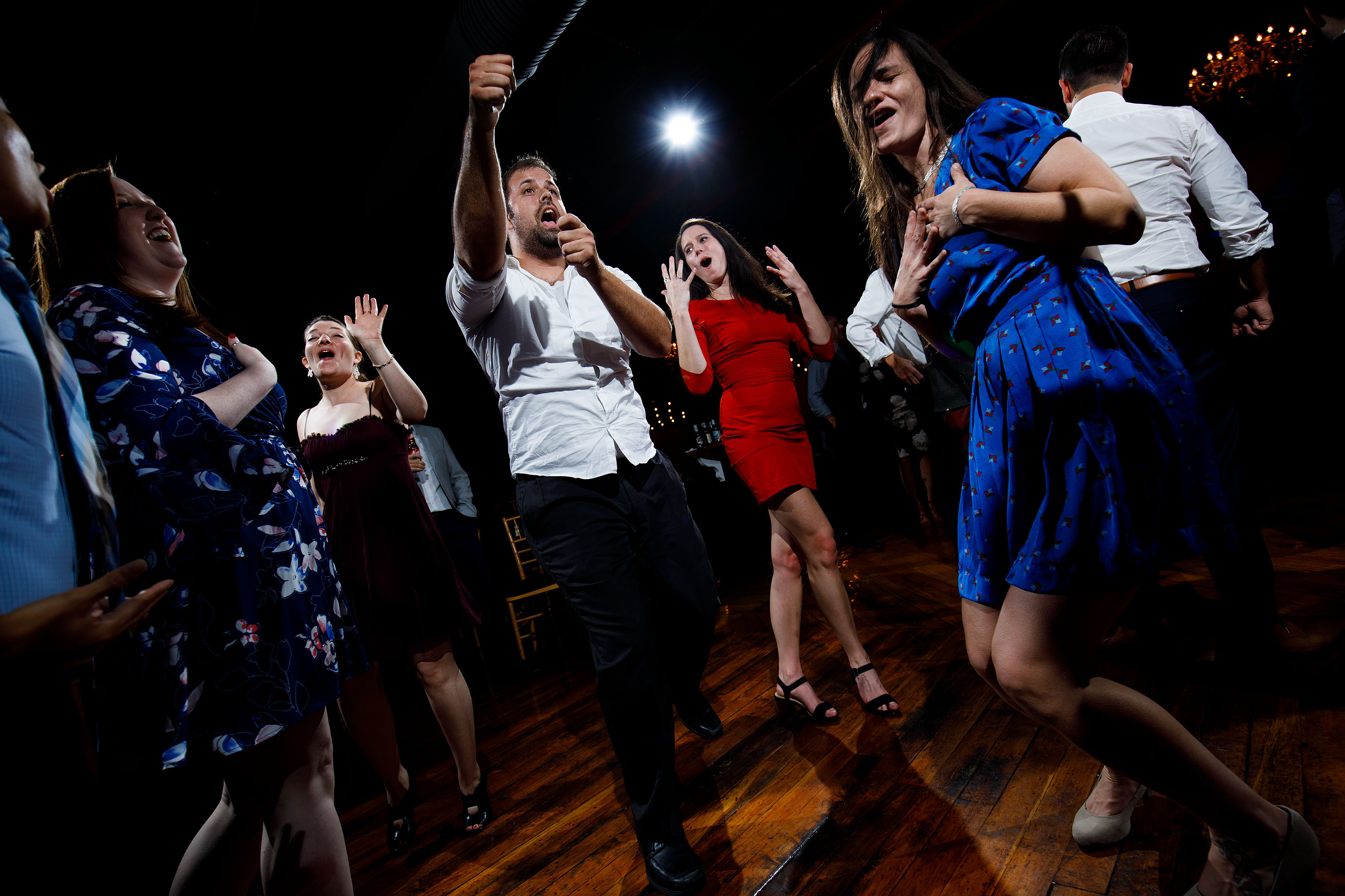 Guests dance at a Madison at the Mill wedding
