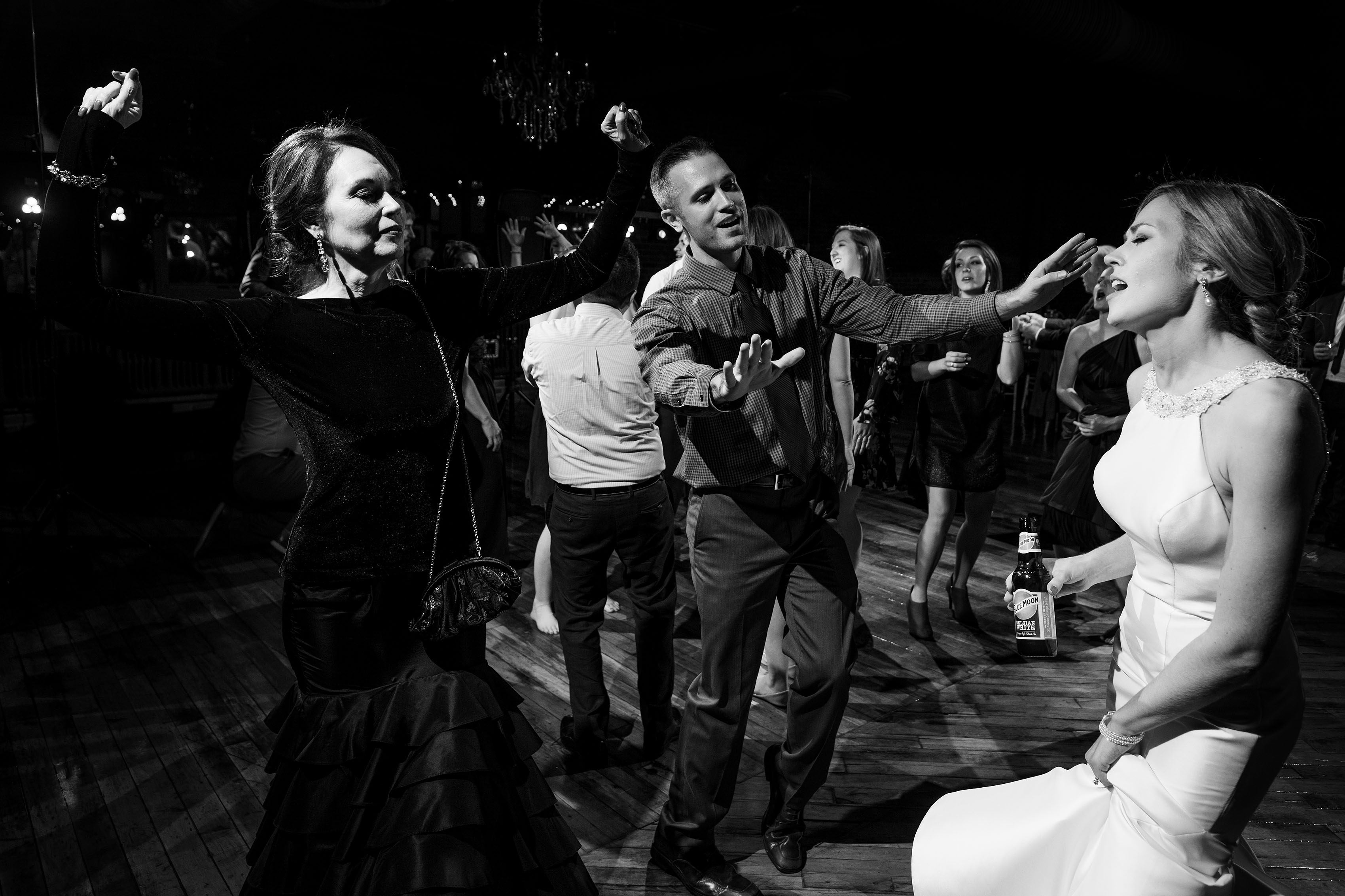 The bride dances with her family at Madison at the Mill