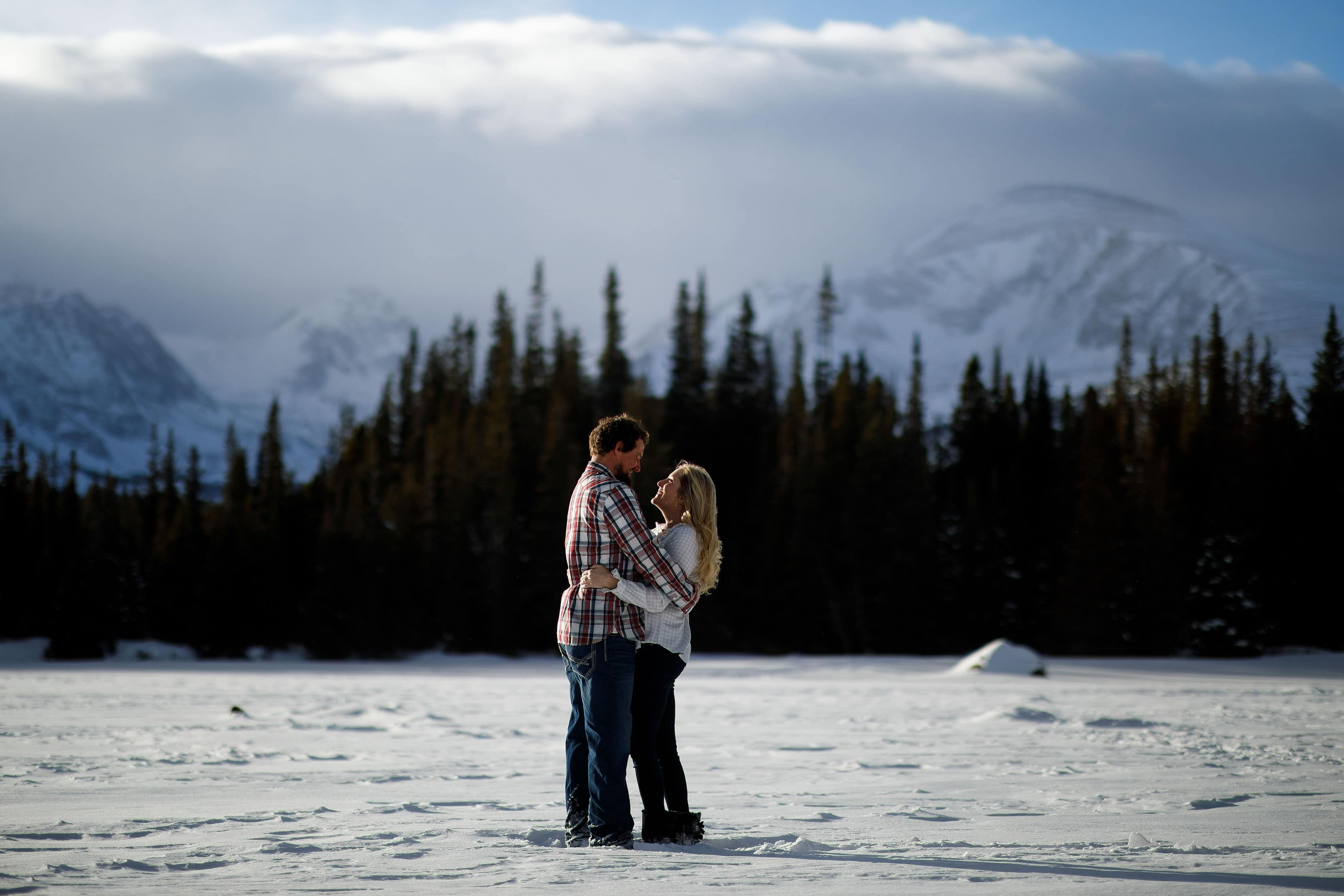 Aaron and Meaghan ebbrace during their winter Brainard Lake Engagement session in January