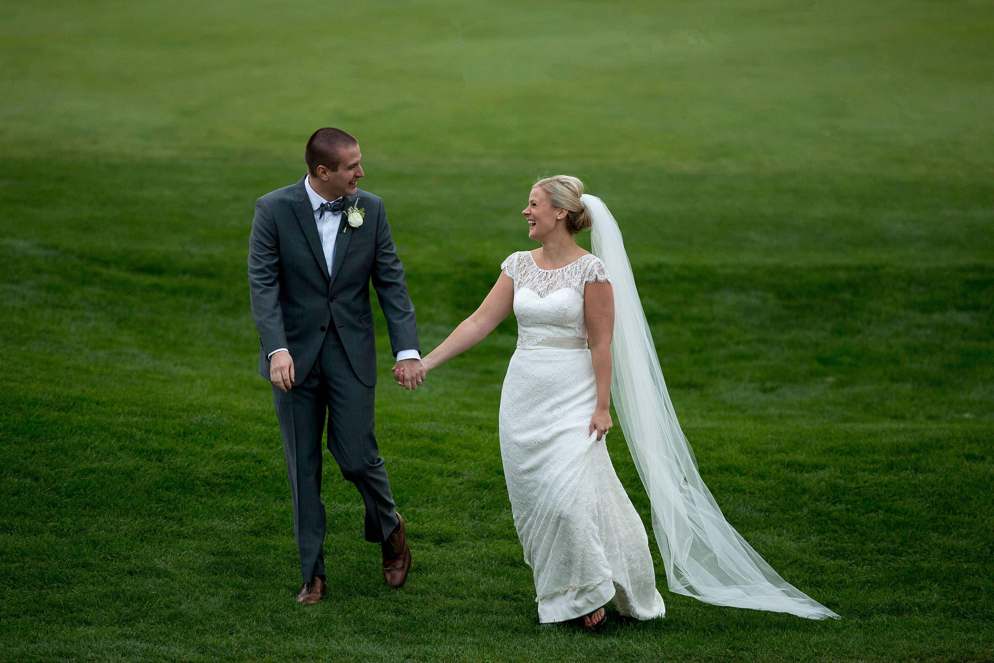 Emily and Ross share a laugh during their Sanctuary Golf Course wedding