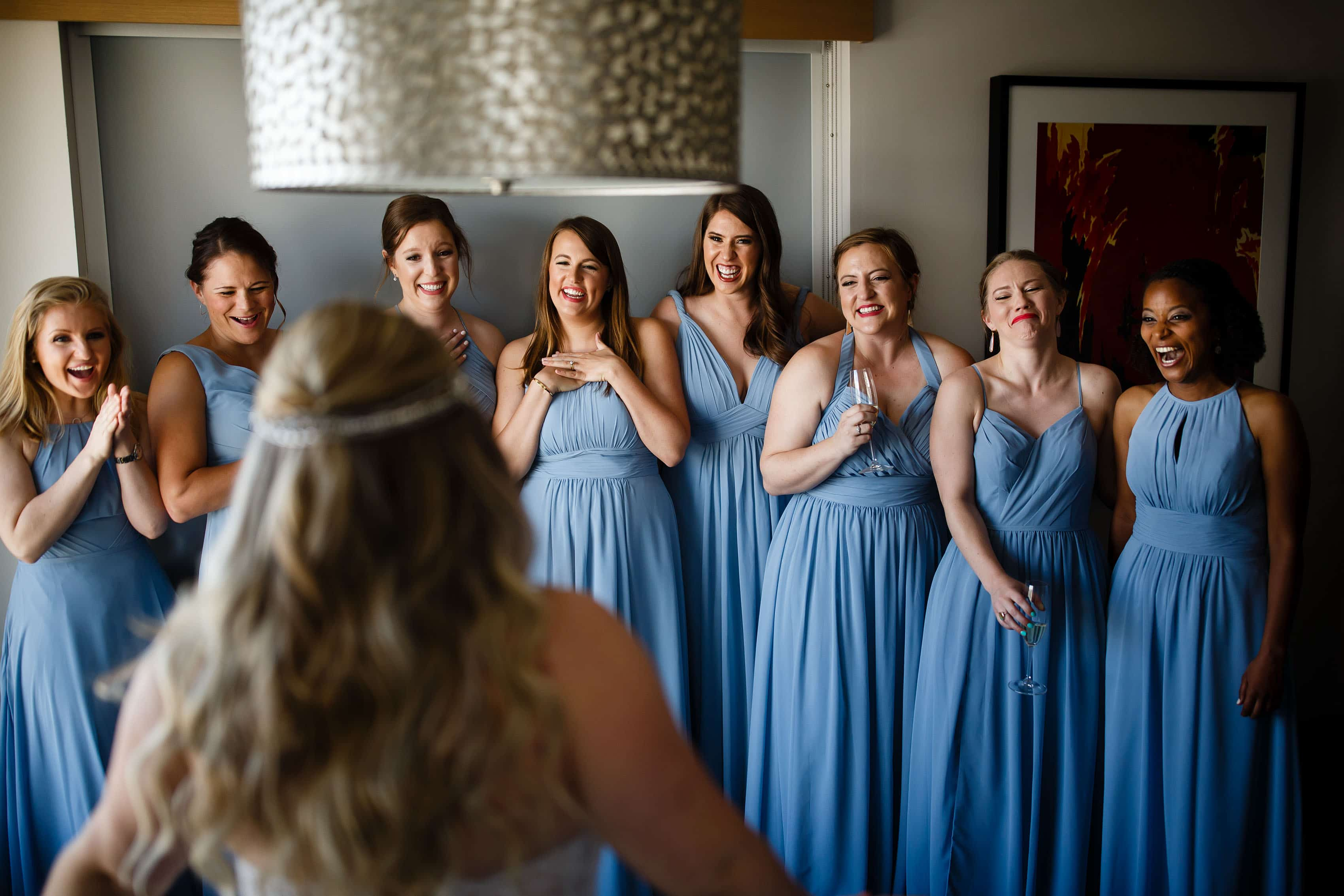 Bridesmaids react at The Art Hotel before the wedding