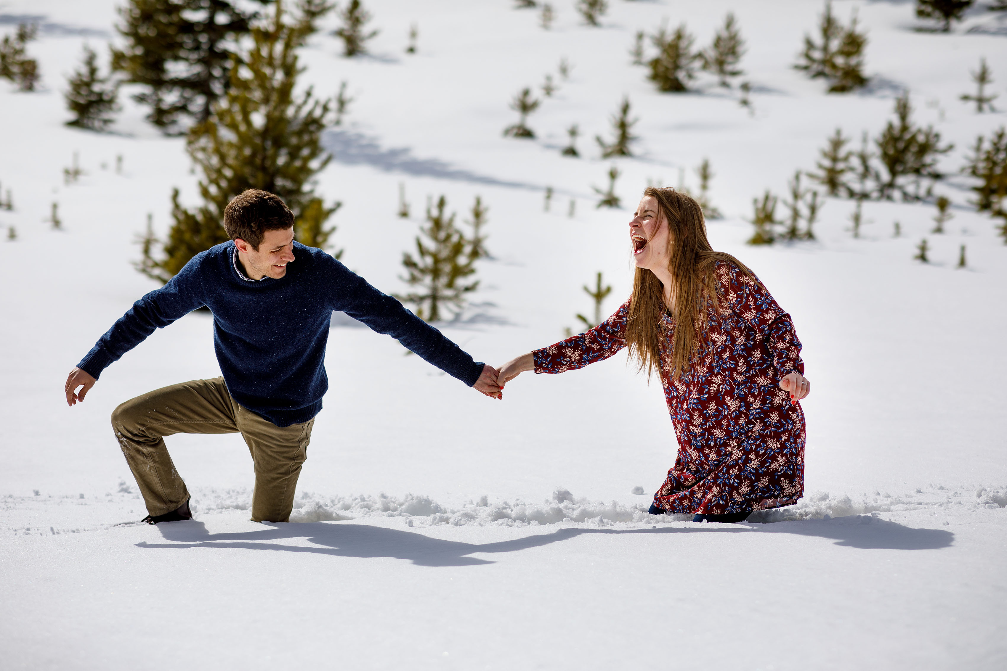 Jessica reacts after falling in the snow with Mike during their engagement session in Dillon