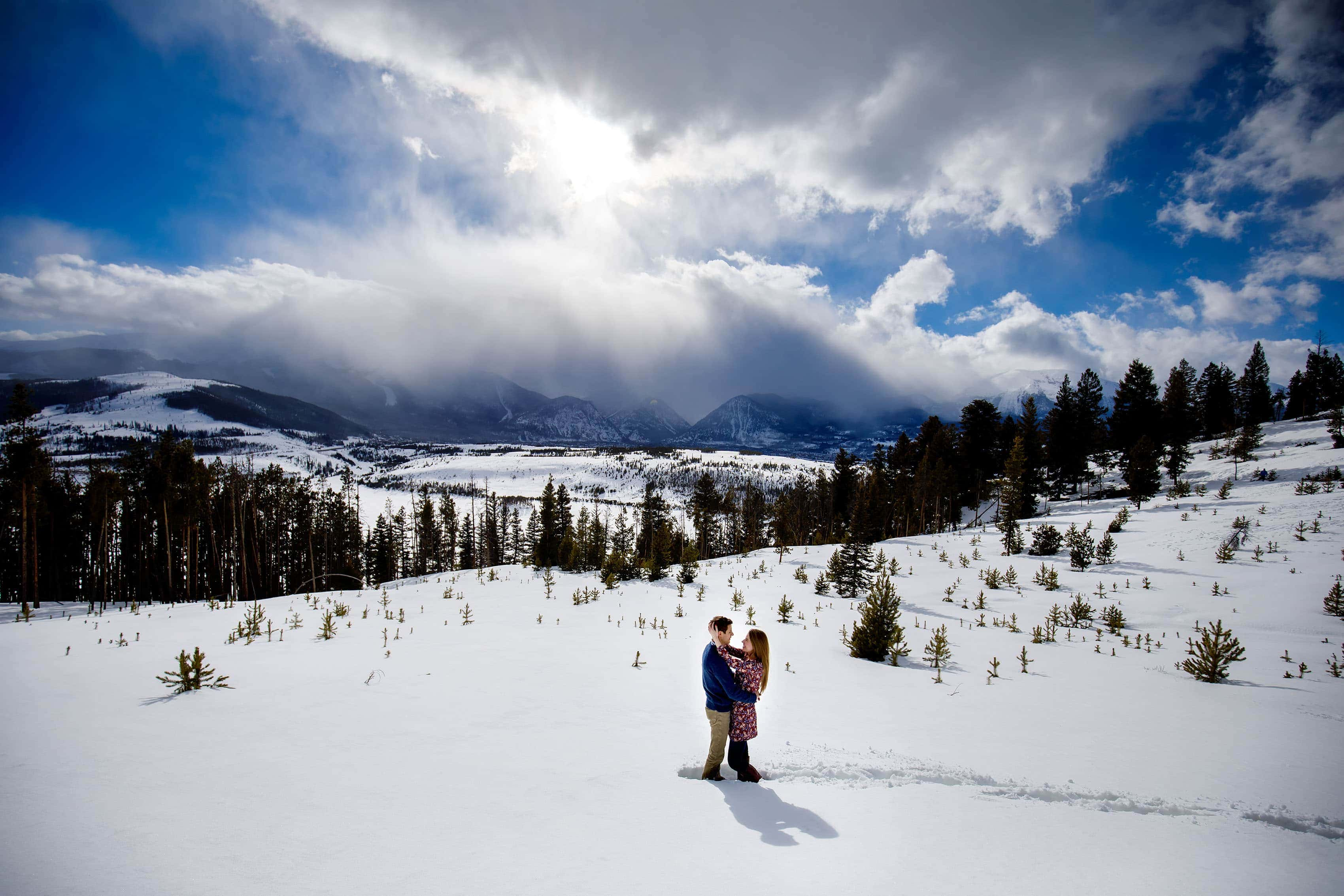 A couple in the snow near Lake Dillon