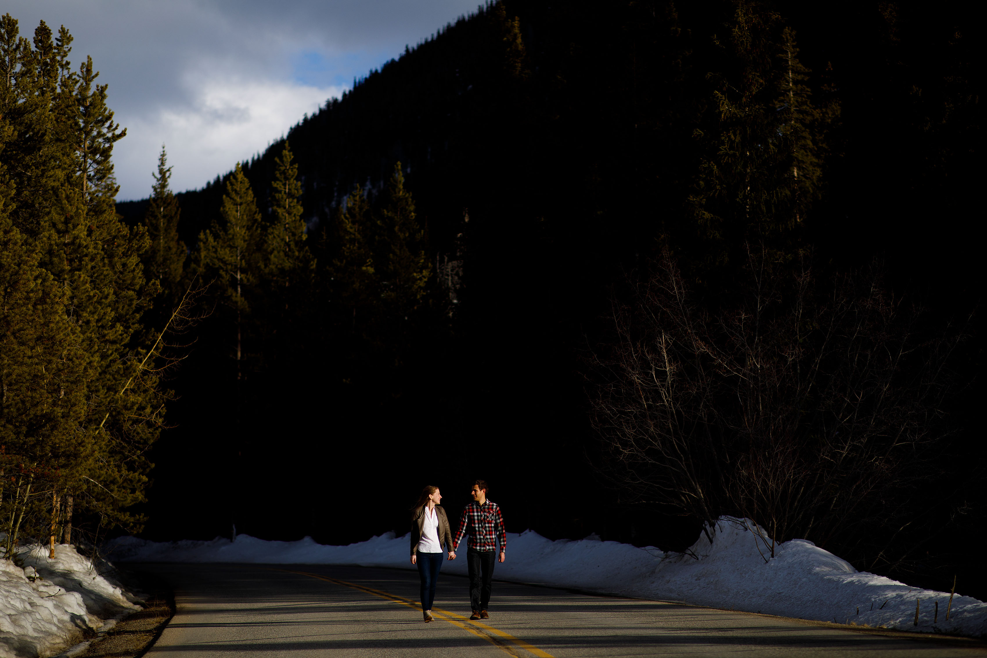 A couple walk together along Montezuma Road during their winter Keystone engagement