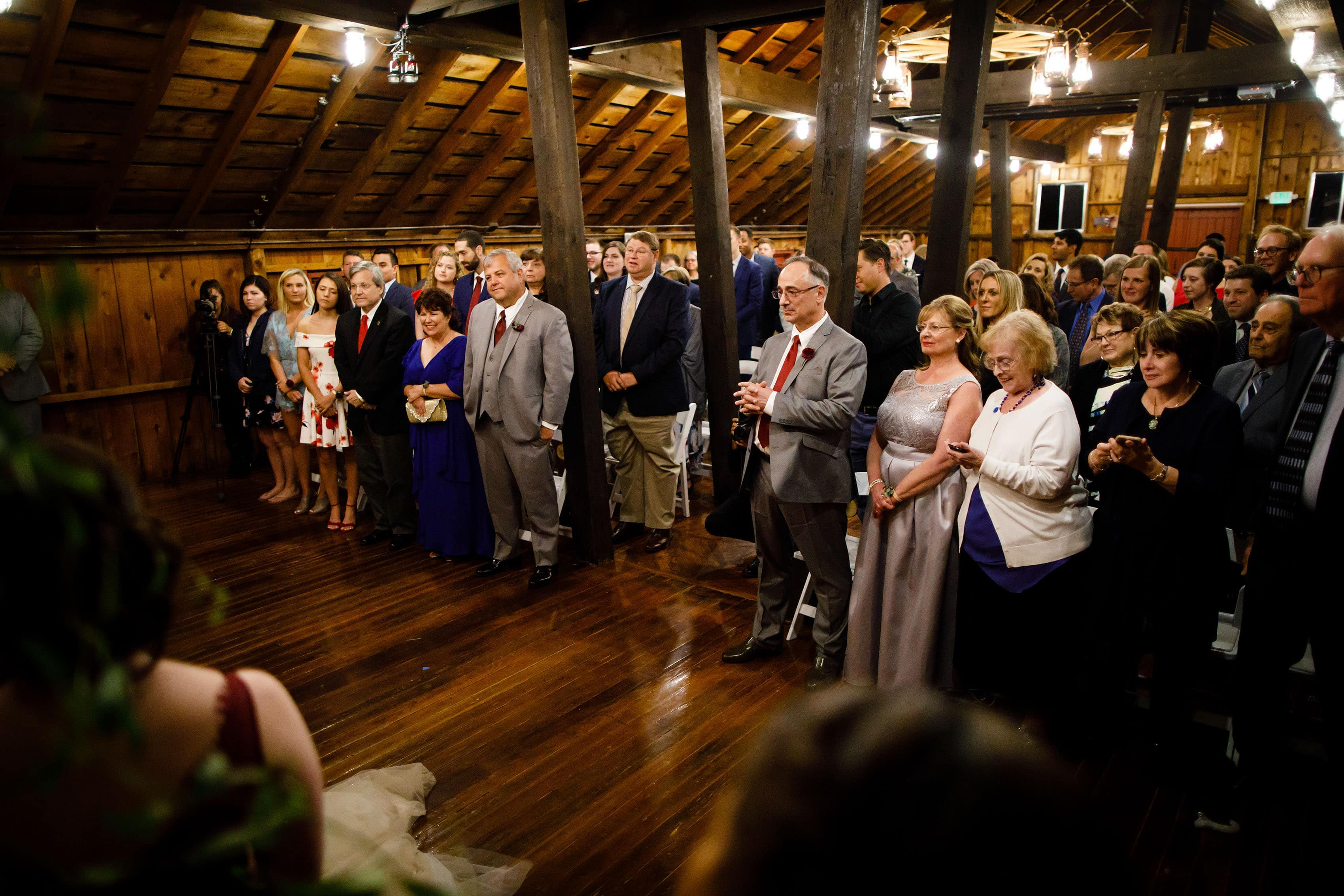 Guests watch a ceremony in Lola's Loft at Crooked Willow Farms