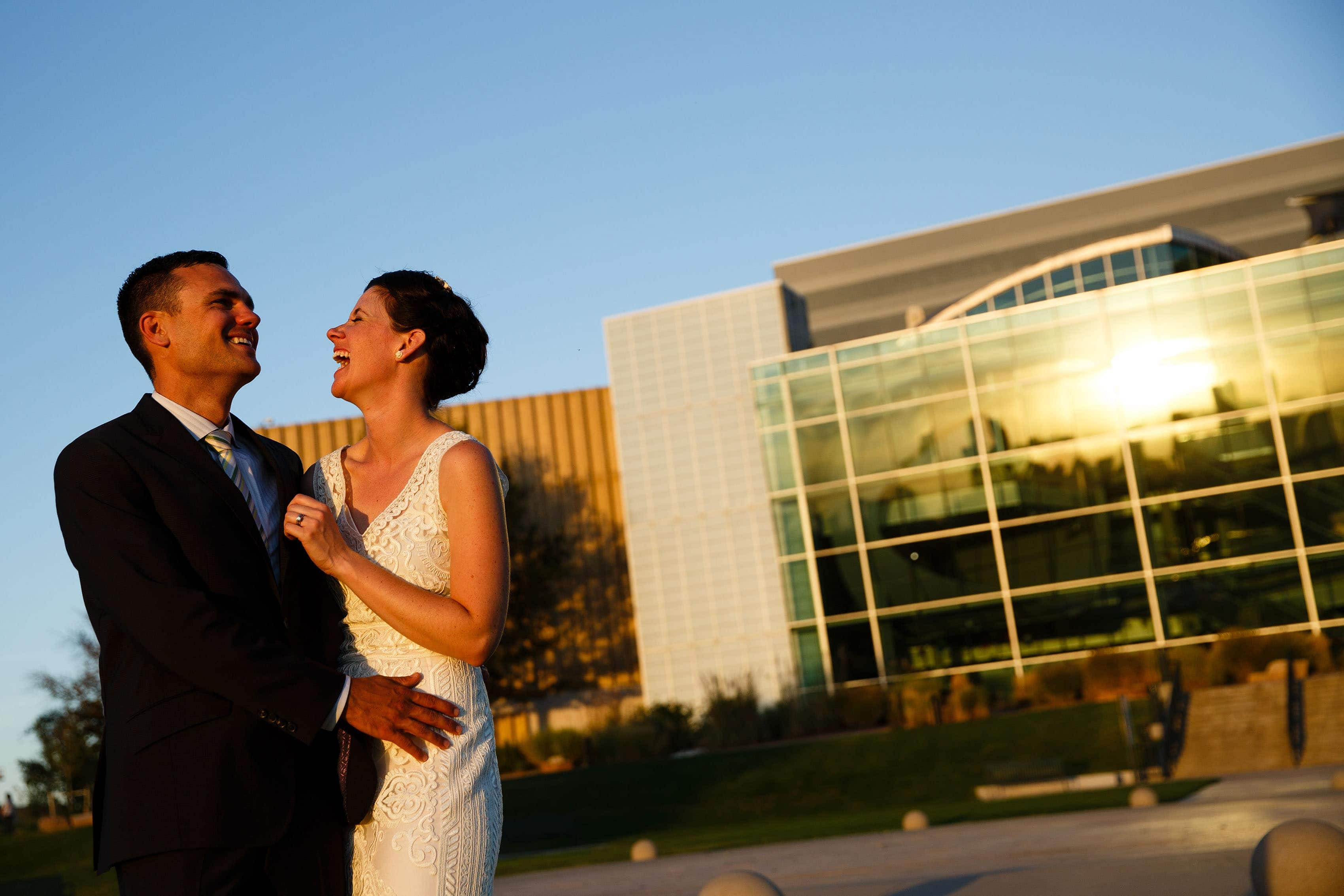 Couple laugh outside the Denver Museum of Nature and Science