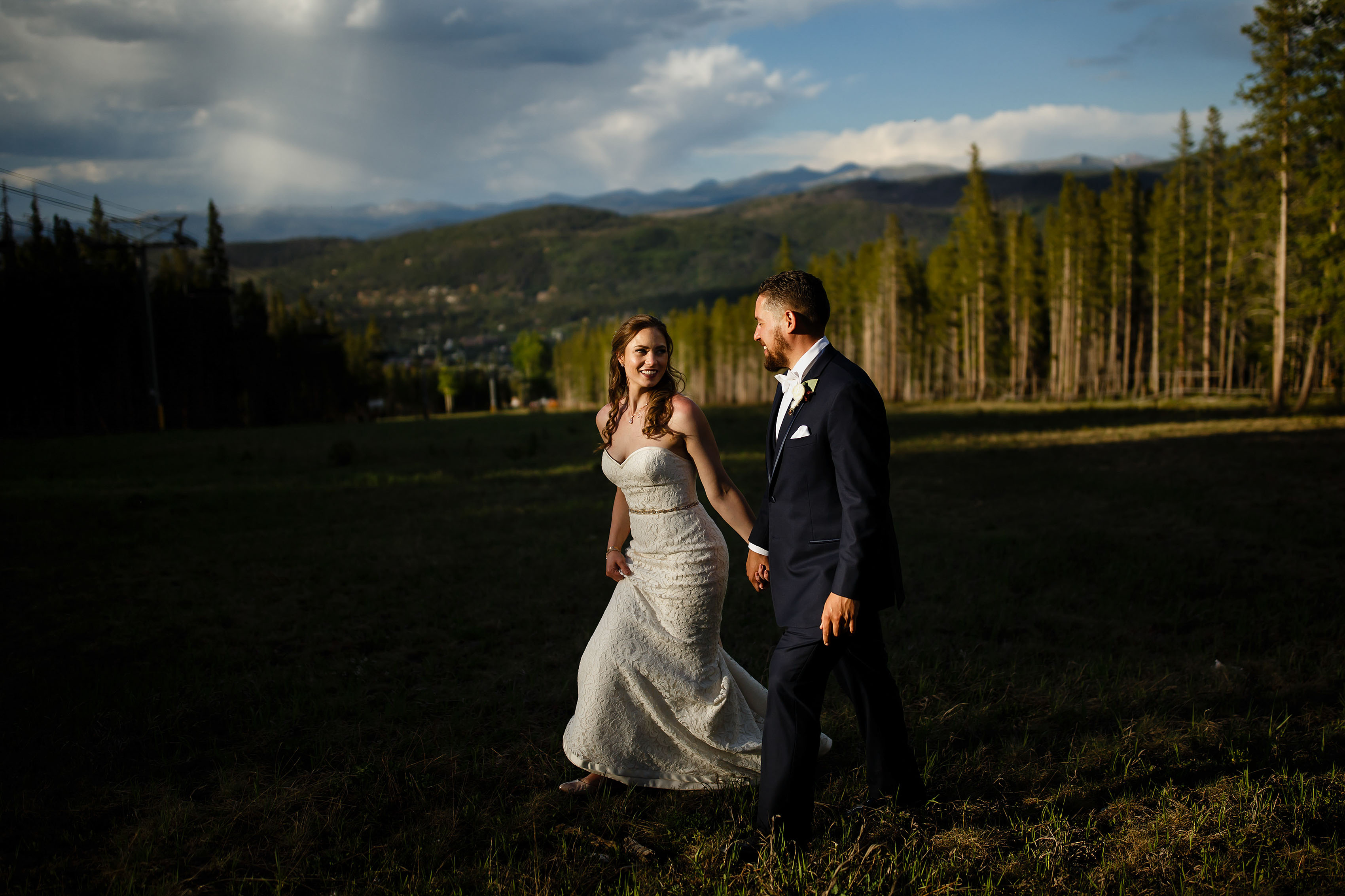 Newlyweds walk together behind Tenmile Station during their wedding