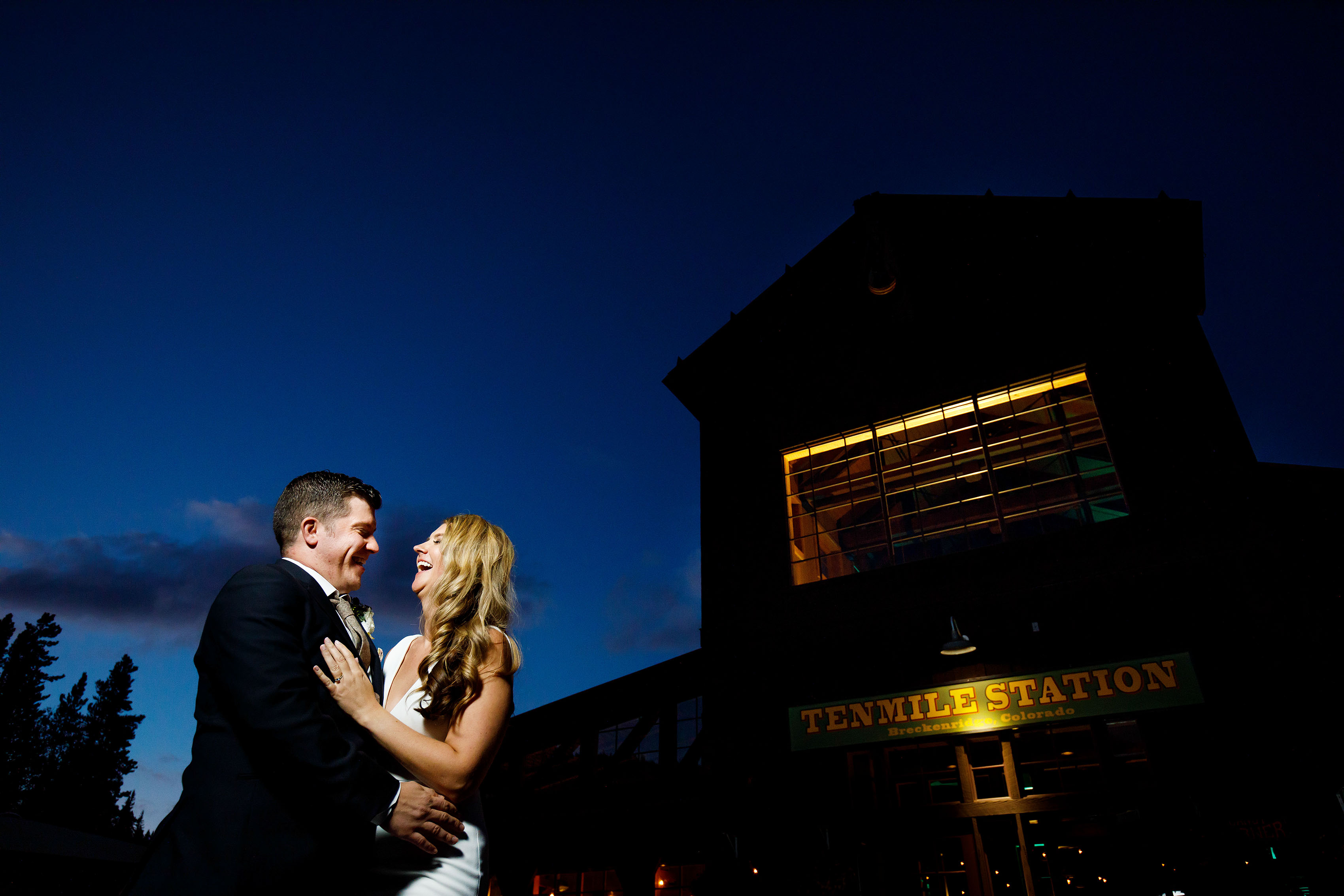 A bride and groom pose for a portrait at twilight during a TenMile Station Wedding