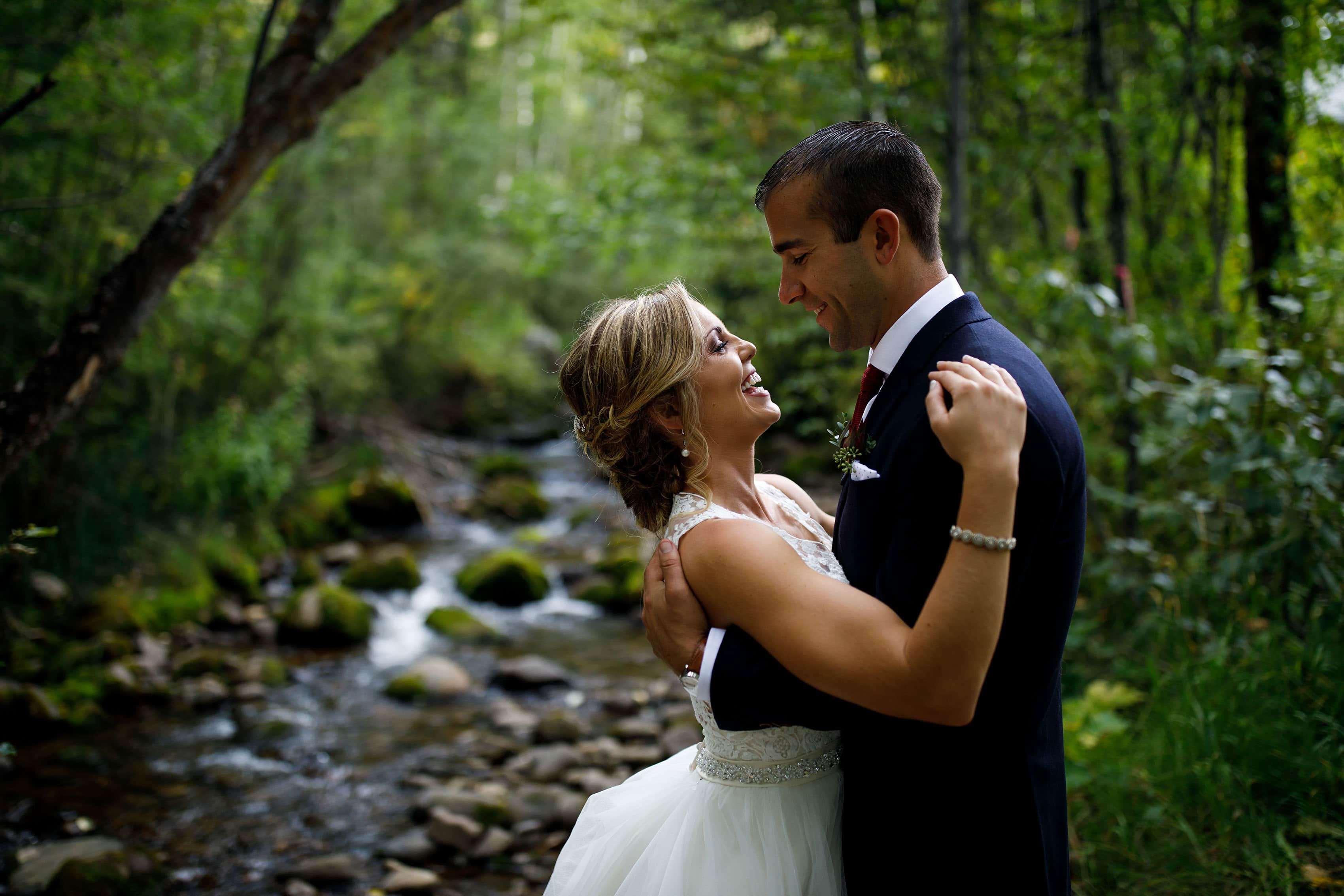 Meghan and Kevin embrace near Beaver Creek after their chapel wedding