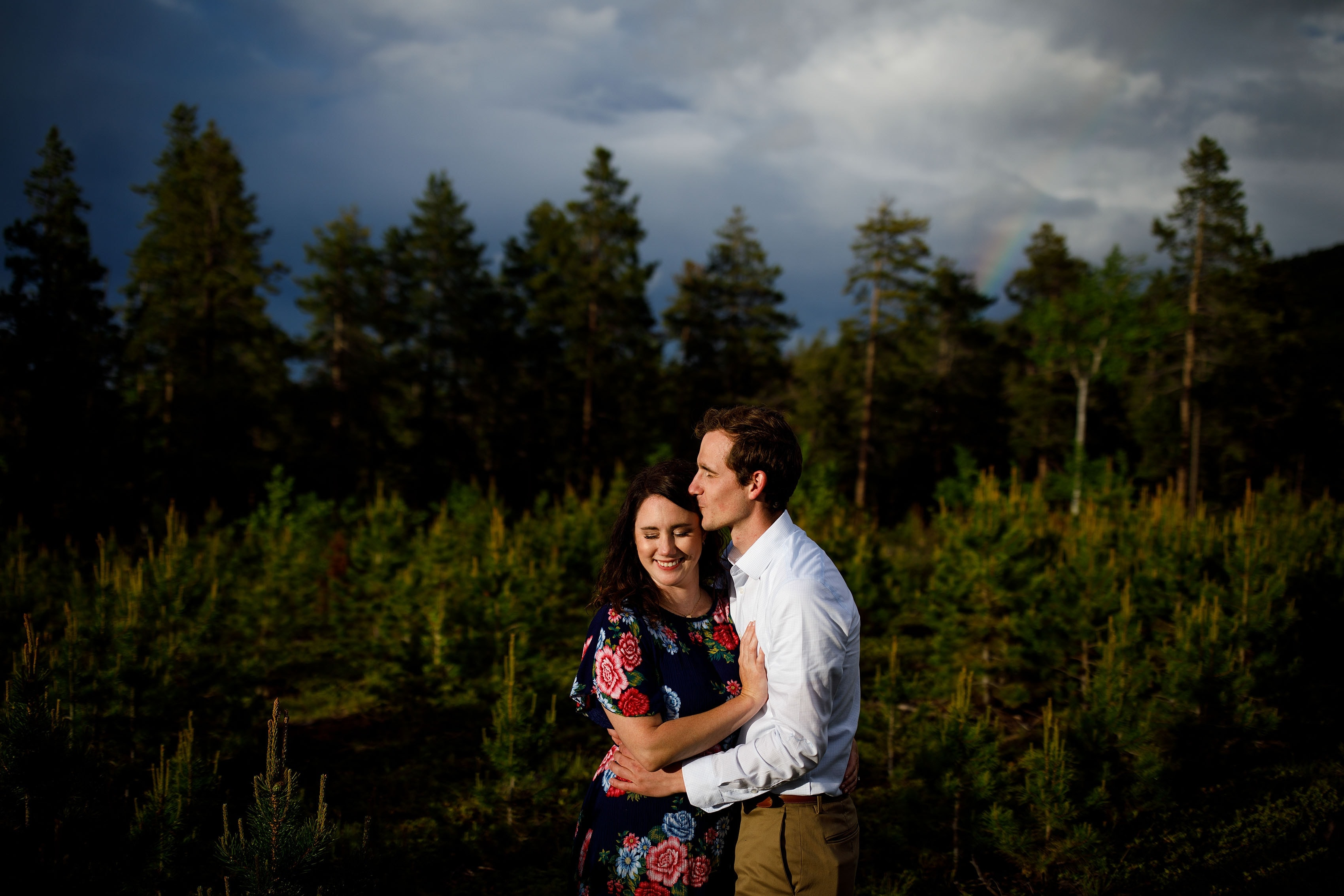 Matthew and Meaghan share a moment near the Maxwell falls trailhead in Evergreen during their engagement photos