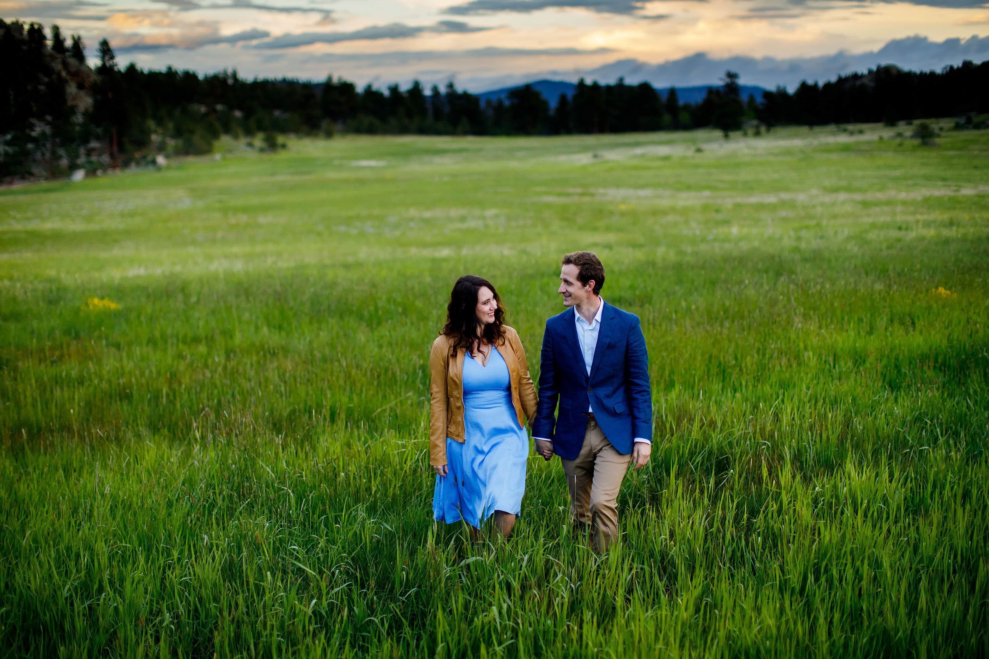 Meaghan and Matthew walk together in the meadow at Alderfer Three Sisters Park during their engagement session