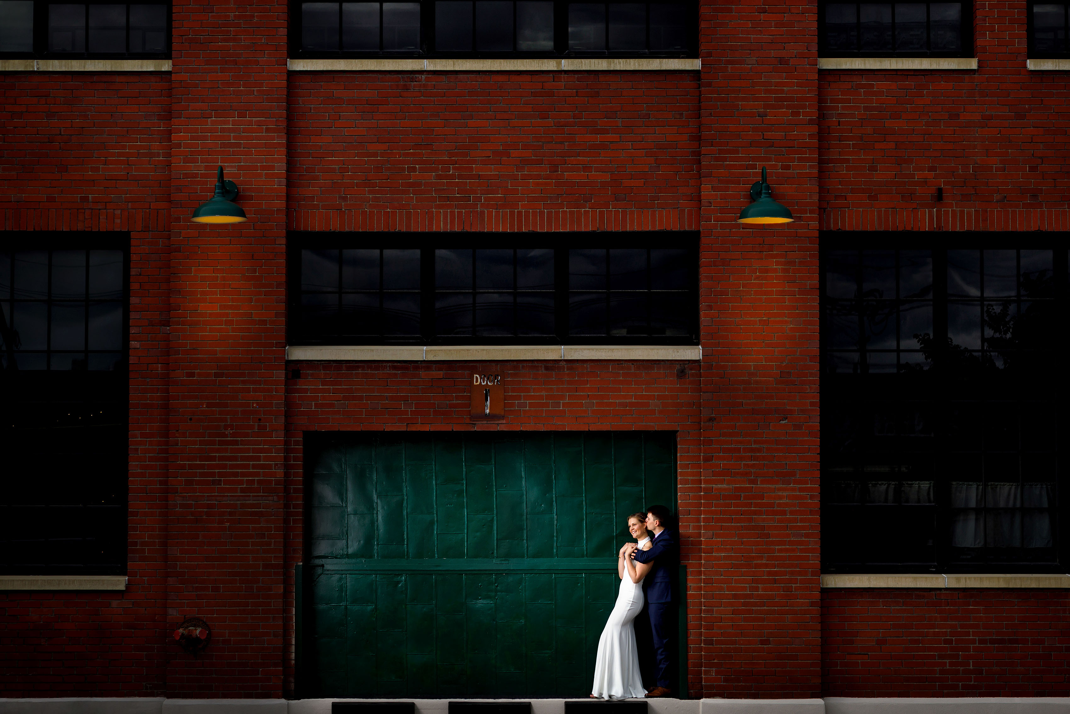 Couple pose for a wedding portrait in the RiNo neighborhood in Denver