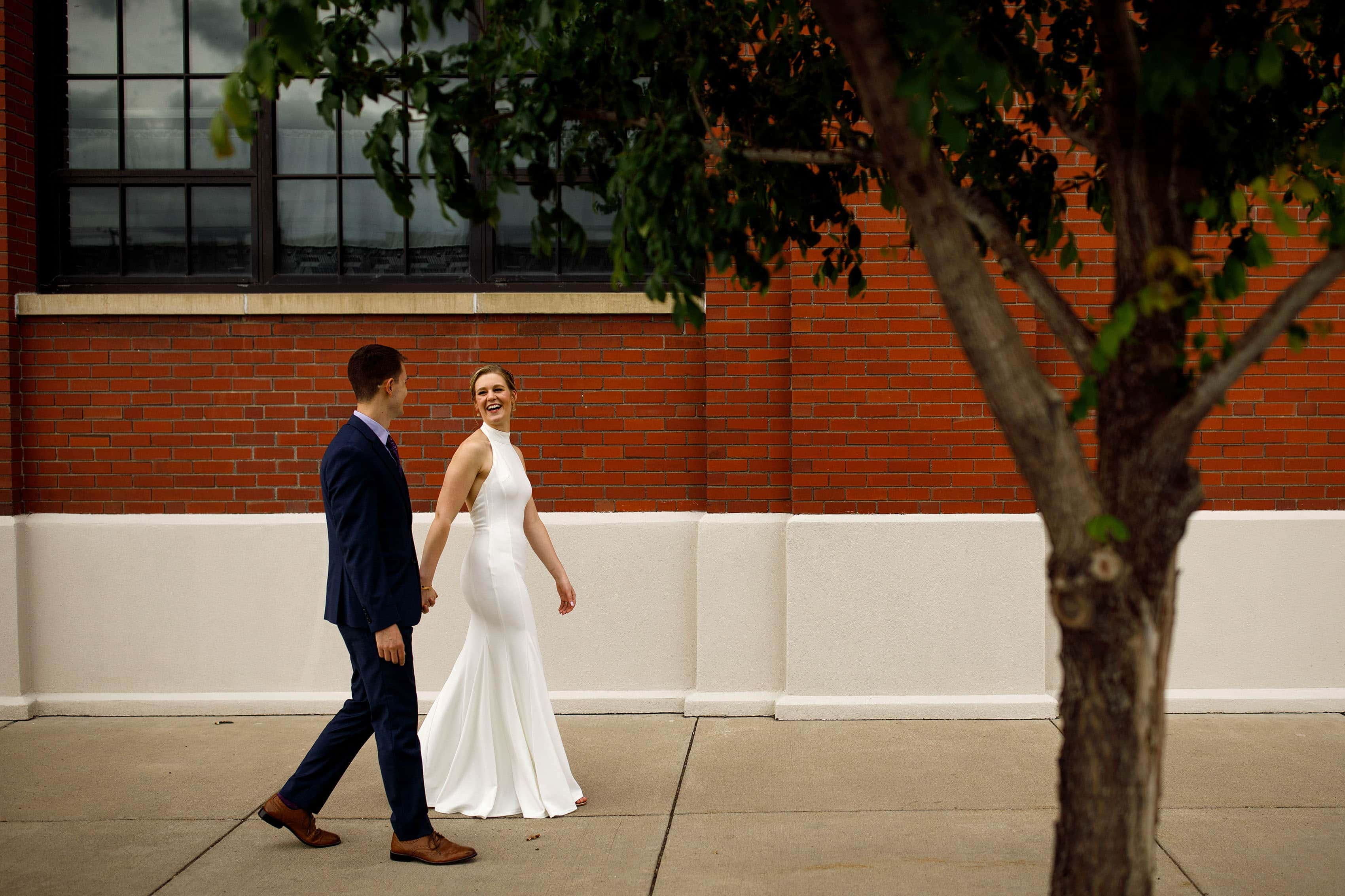 Newlyweds walk together in RiNo
