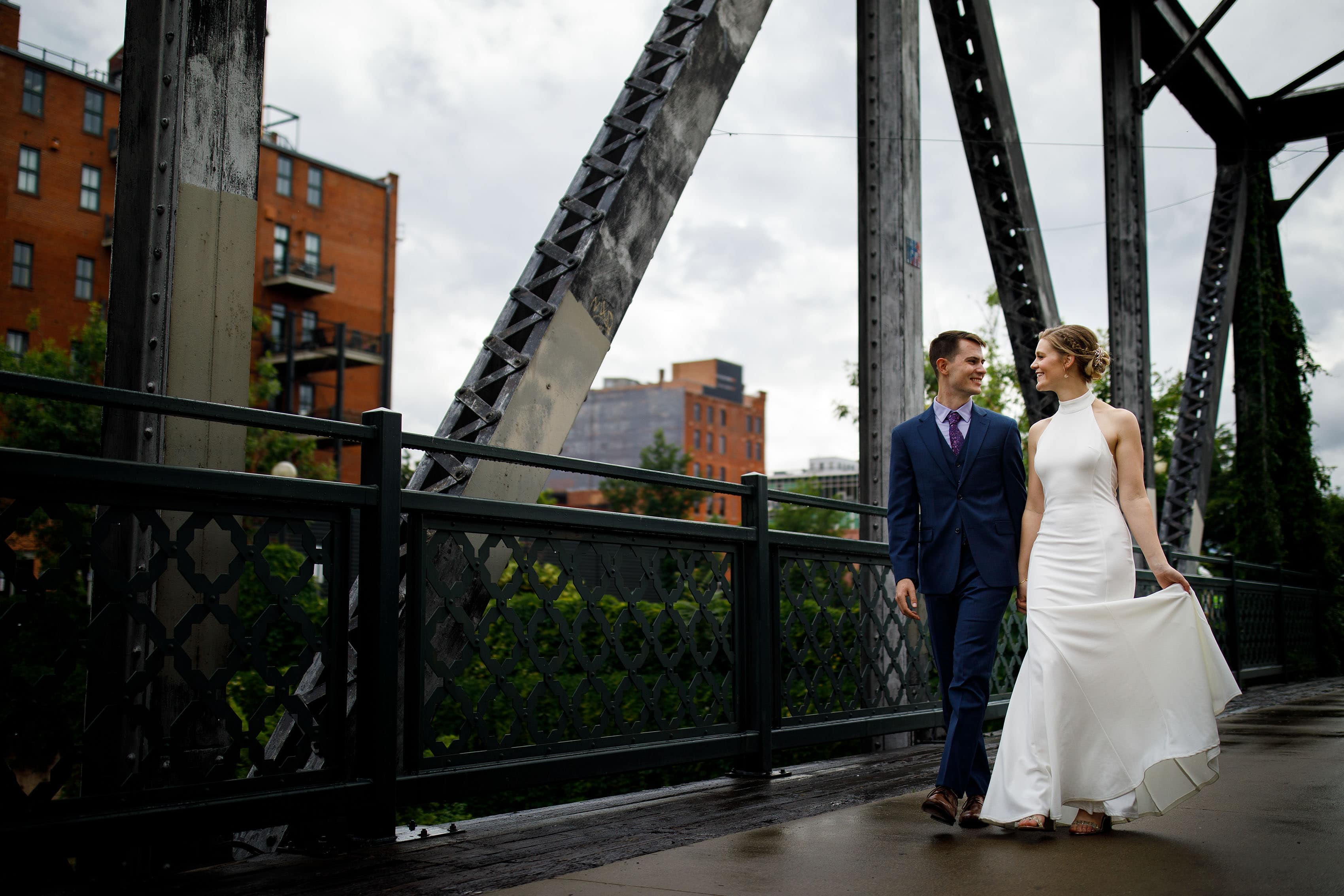 Newlyweds walk together on the Wynkoop Street Bridge in Denver's LoDo neighborhood