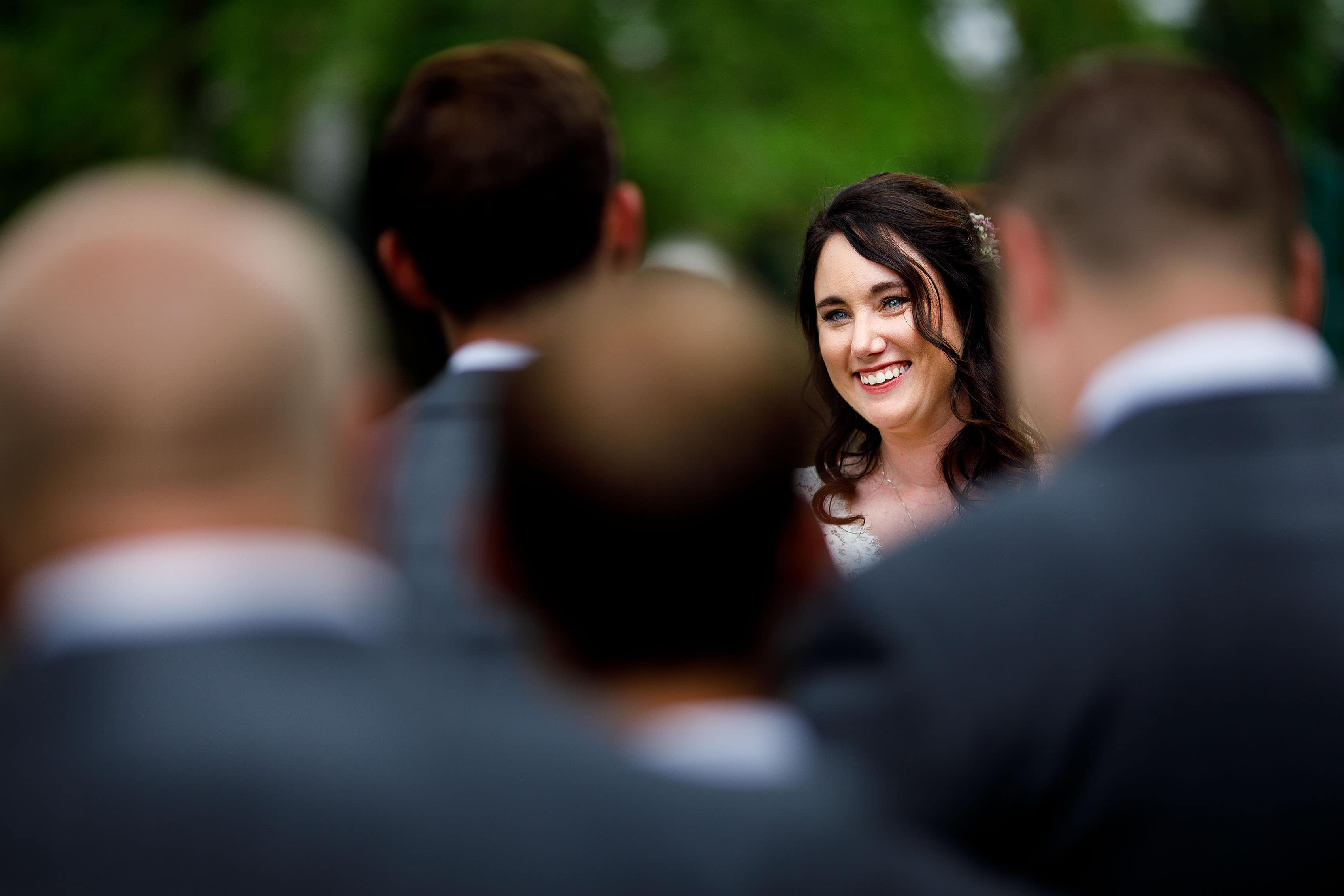 Bide smiles during the wedding ceremony