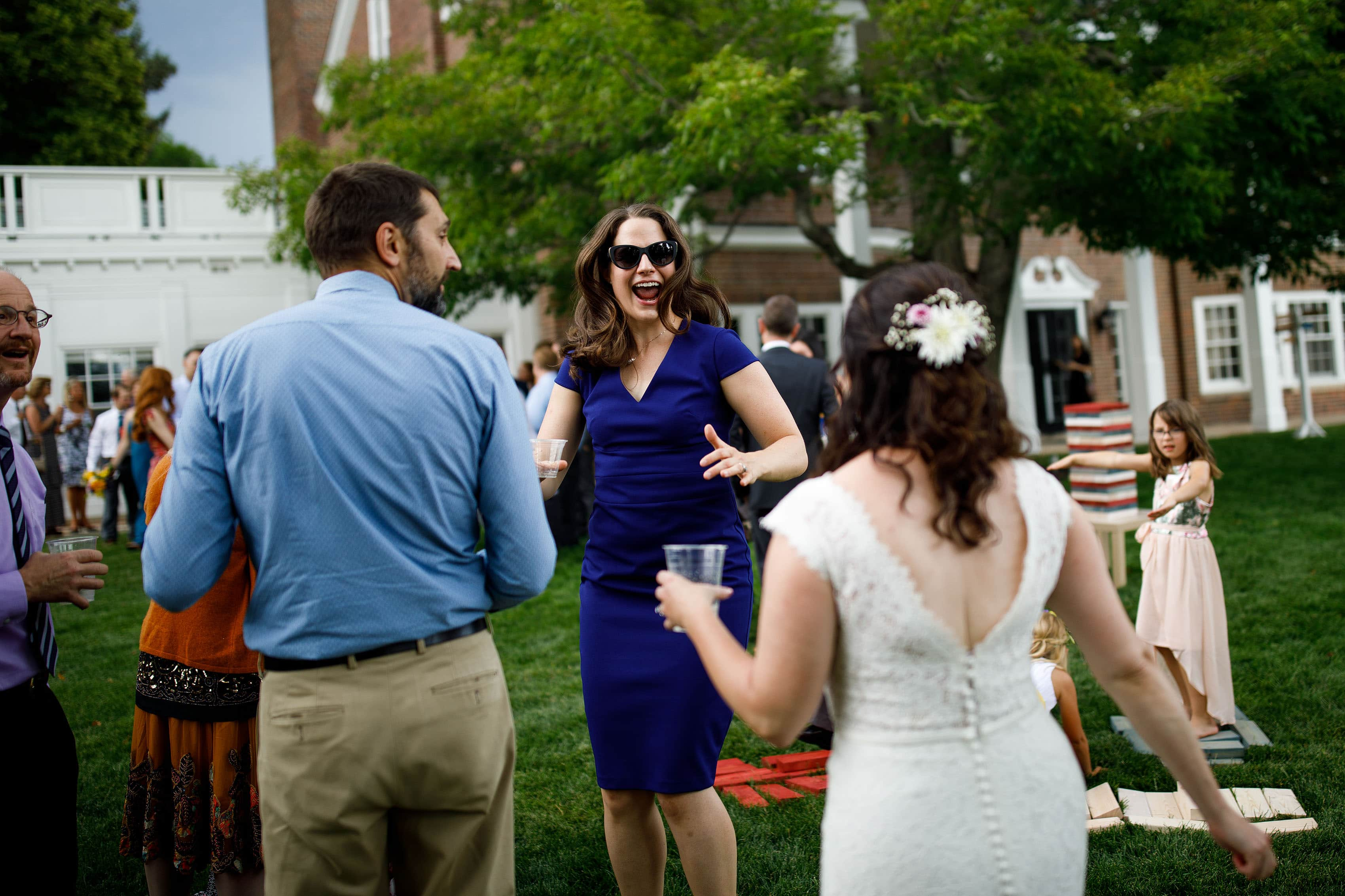 Guests react during a wedding reception at the Buell Mansion