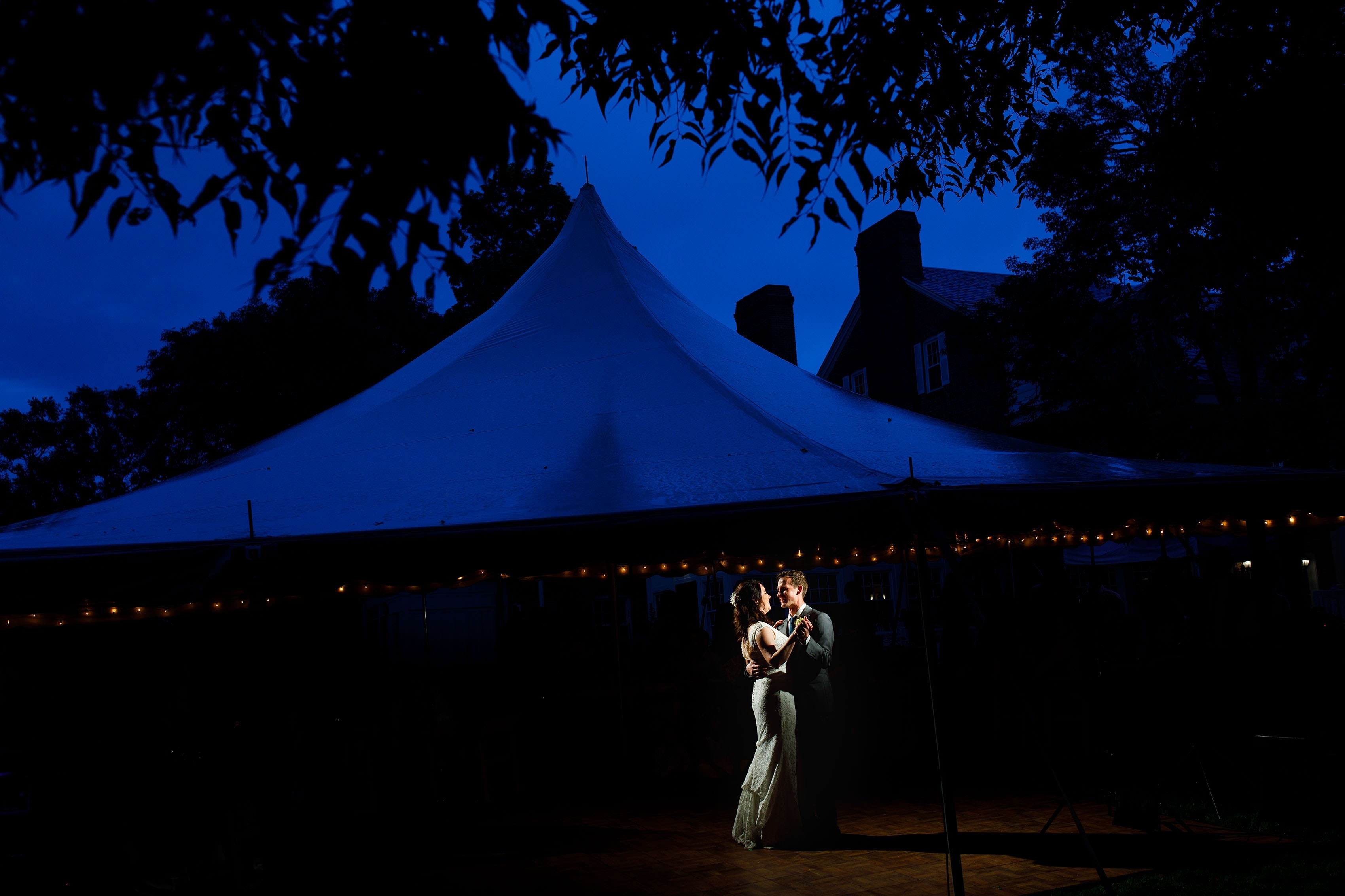 Meaghan and Matthew enjoy their first dance under the tent during their Buell Mansion wedding reception