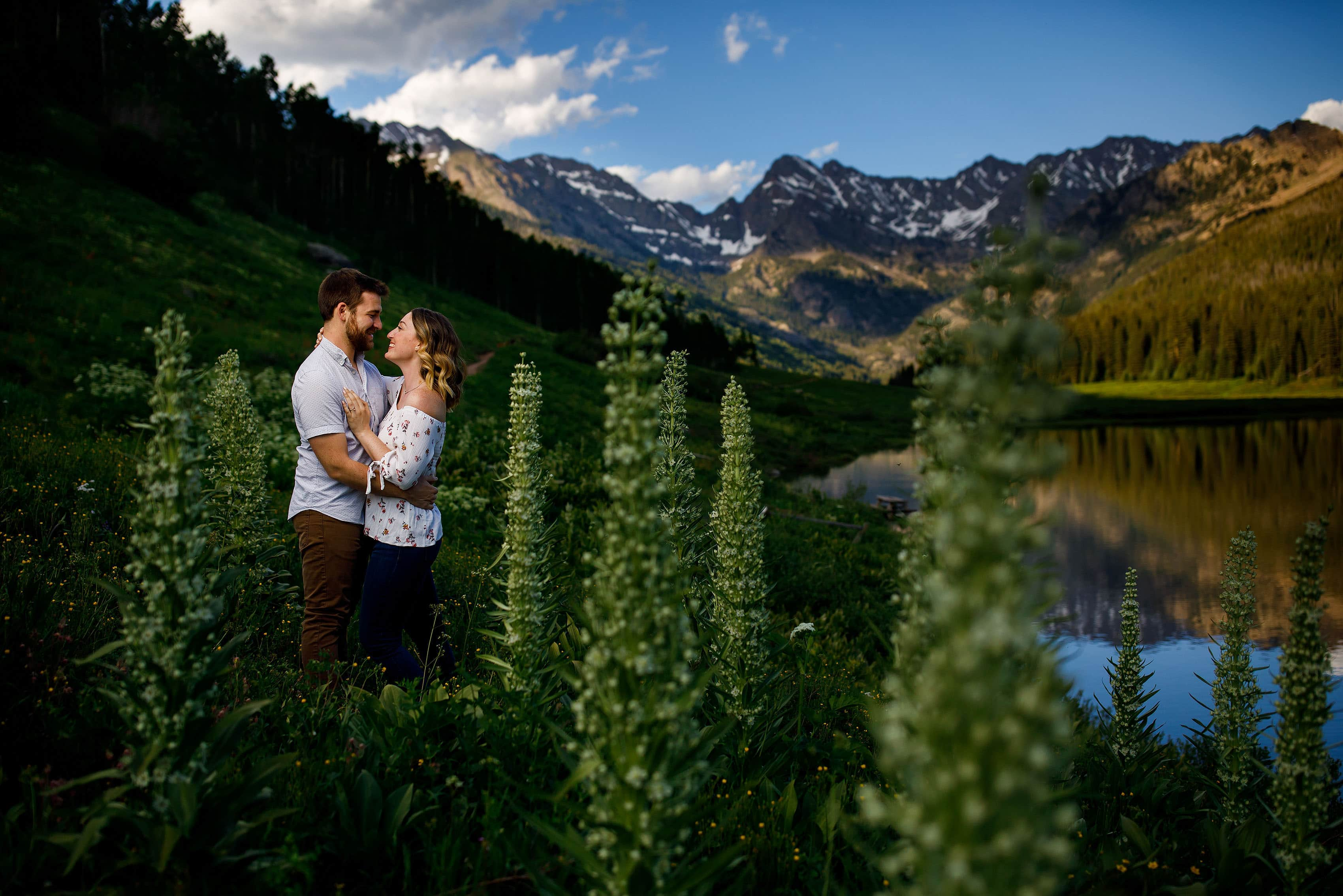 Ryan and Laura embrace during their engagement session at Piney Lake near Vail, Colorado