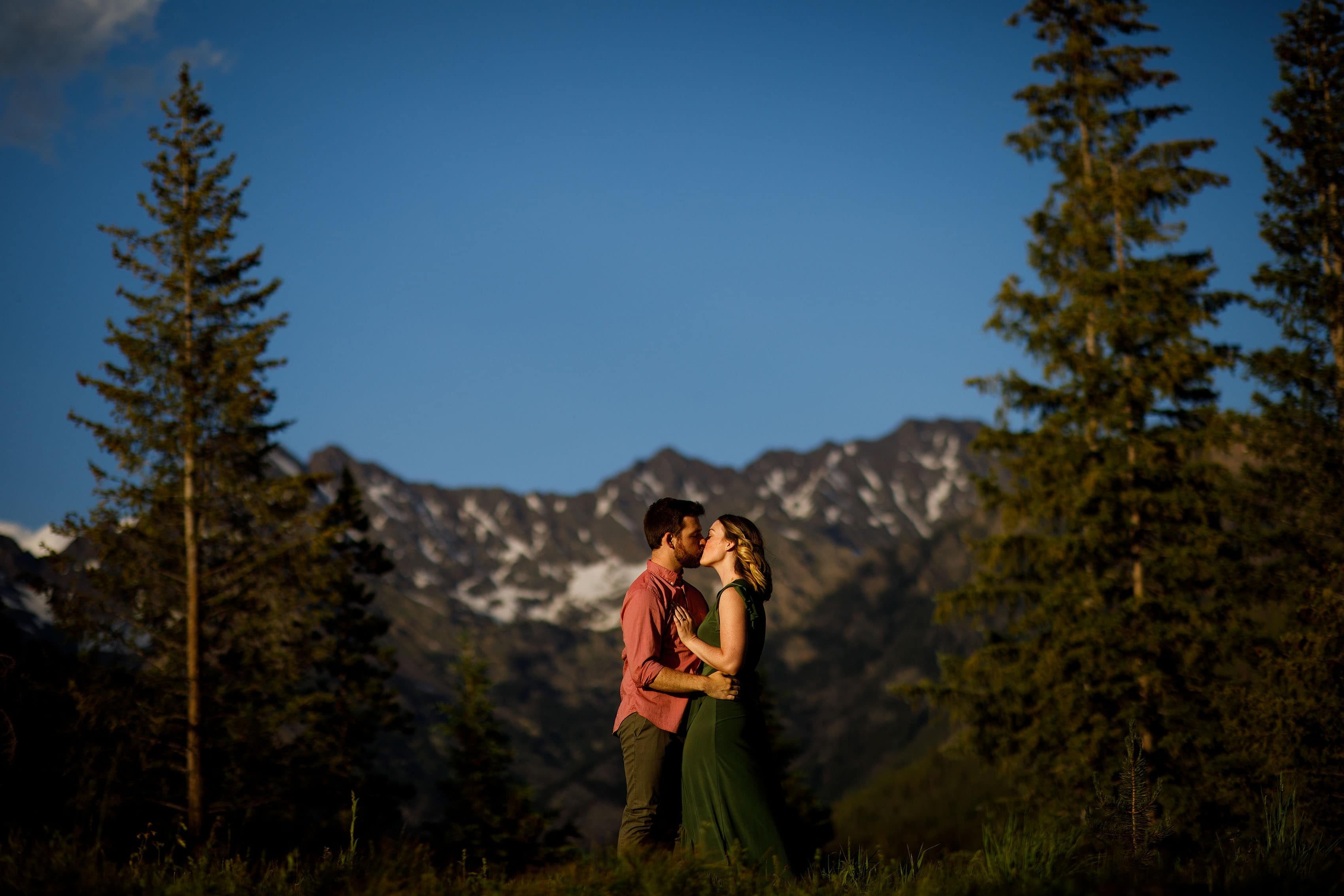 A couple kisses during sunset at Piney River Ranch during their engagement session