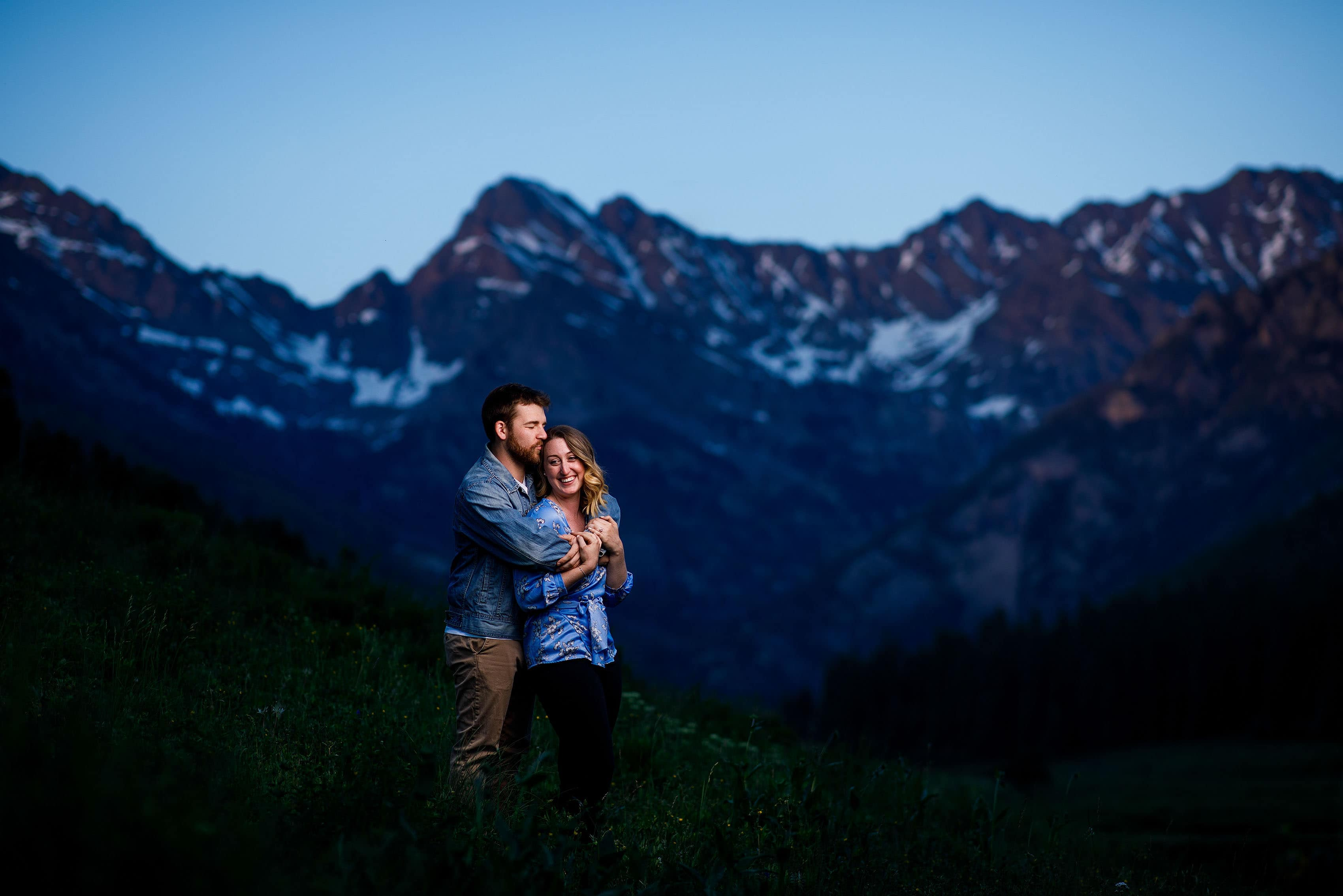 Laura and Ryan pose during their engagement at Piney River Ranch