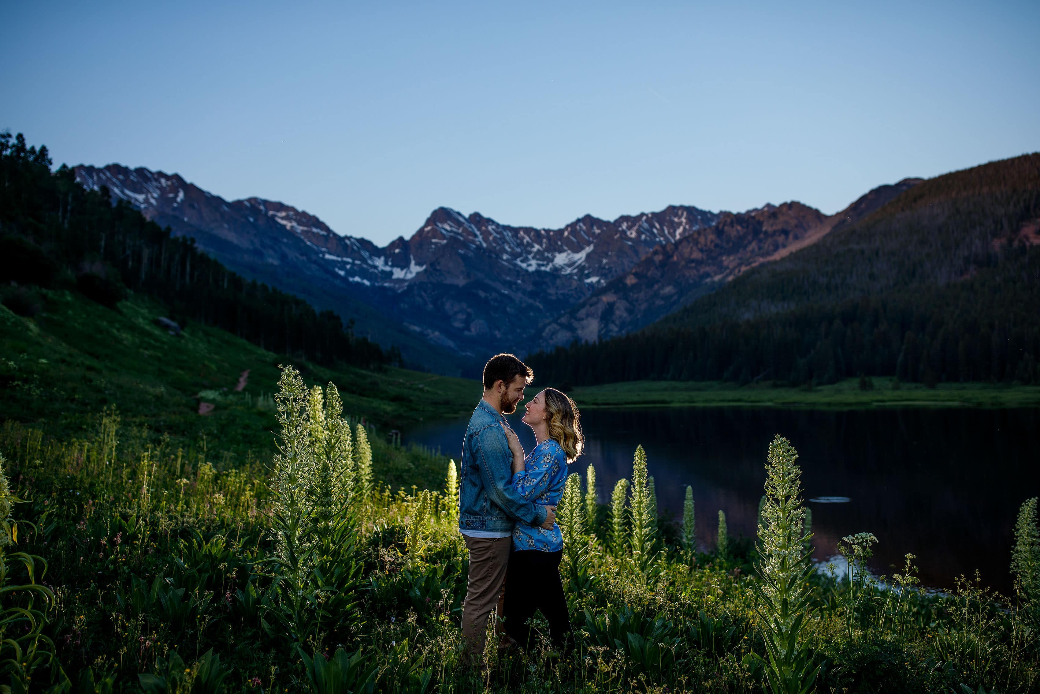 A couple share a moment during their Piney River Ranch engagement at twilight