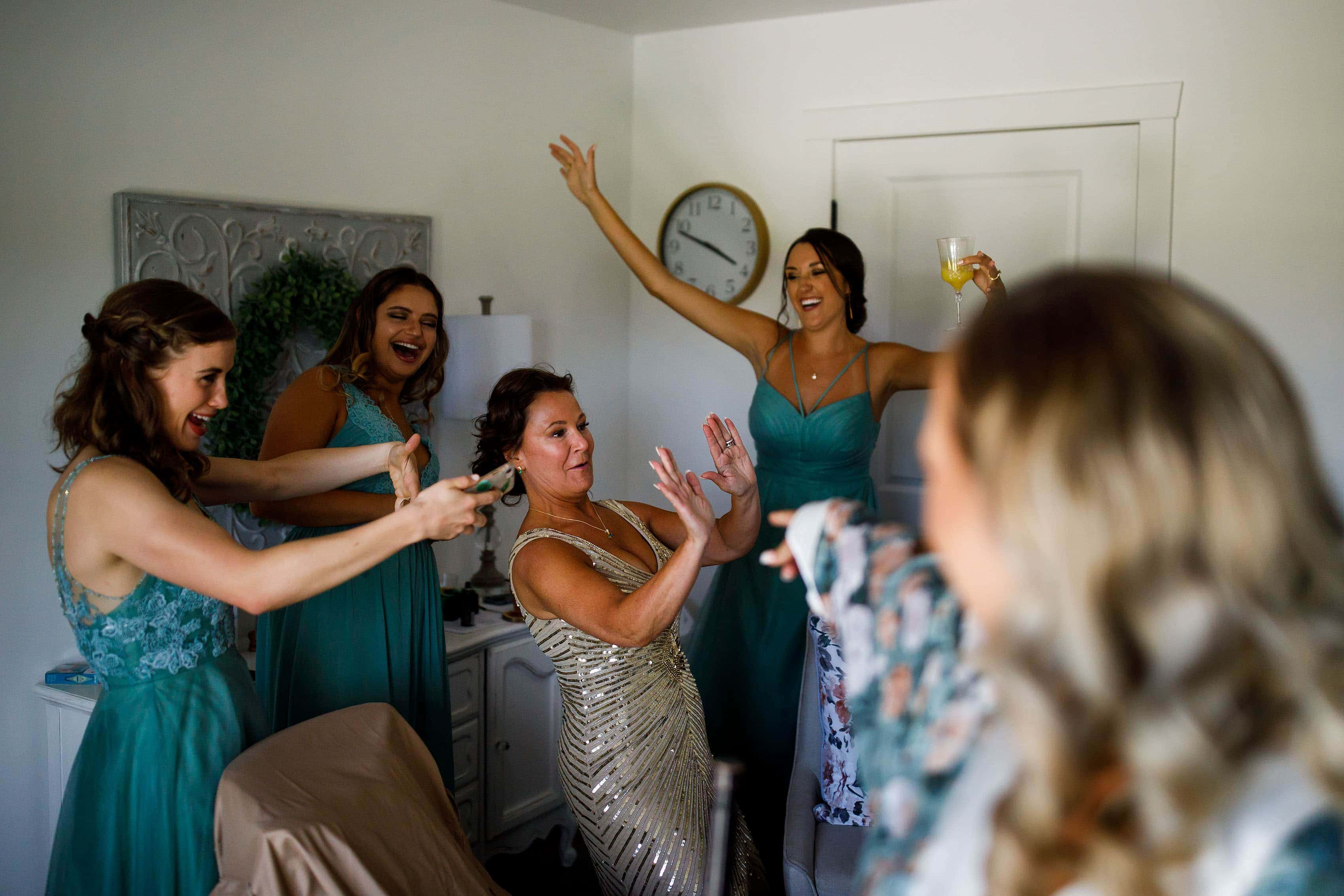 Bridesmaids dance with the mother of the bride at Emerson Fields