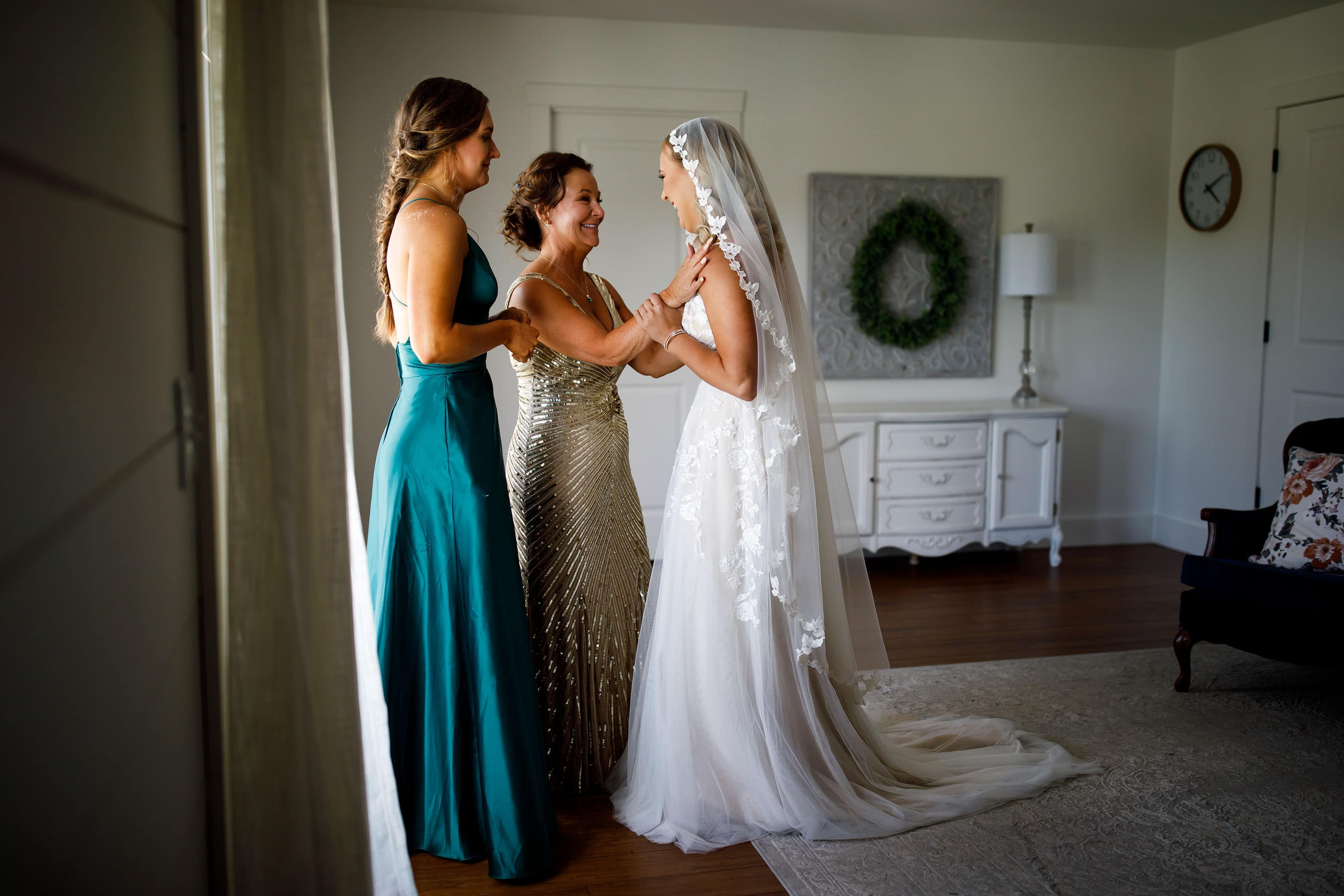A bride and mother share a moment together in the bridal suite at Emerson Fields