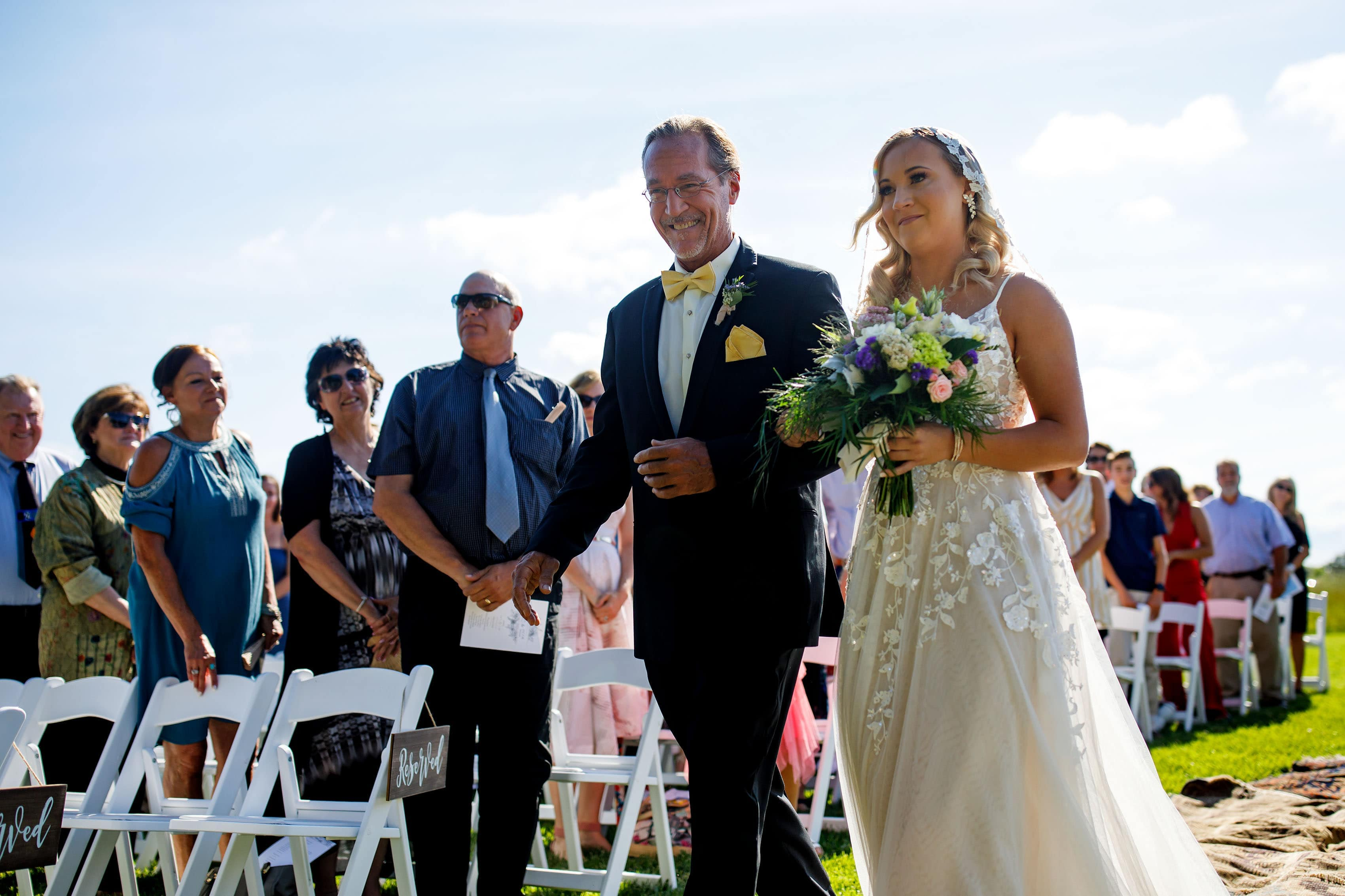 Sienna walks down the aisle with her father