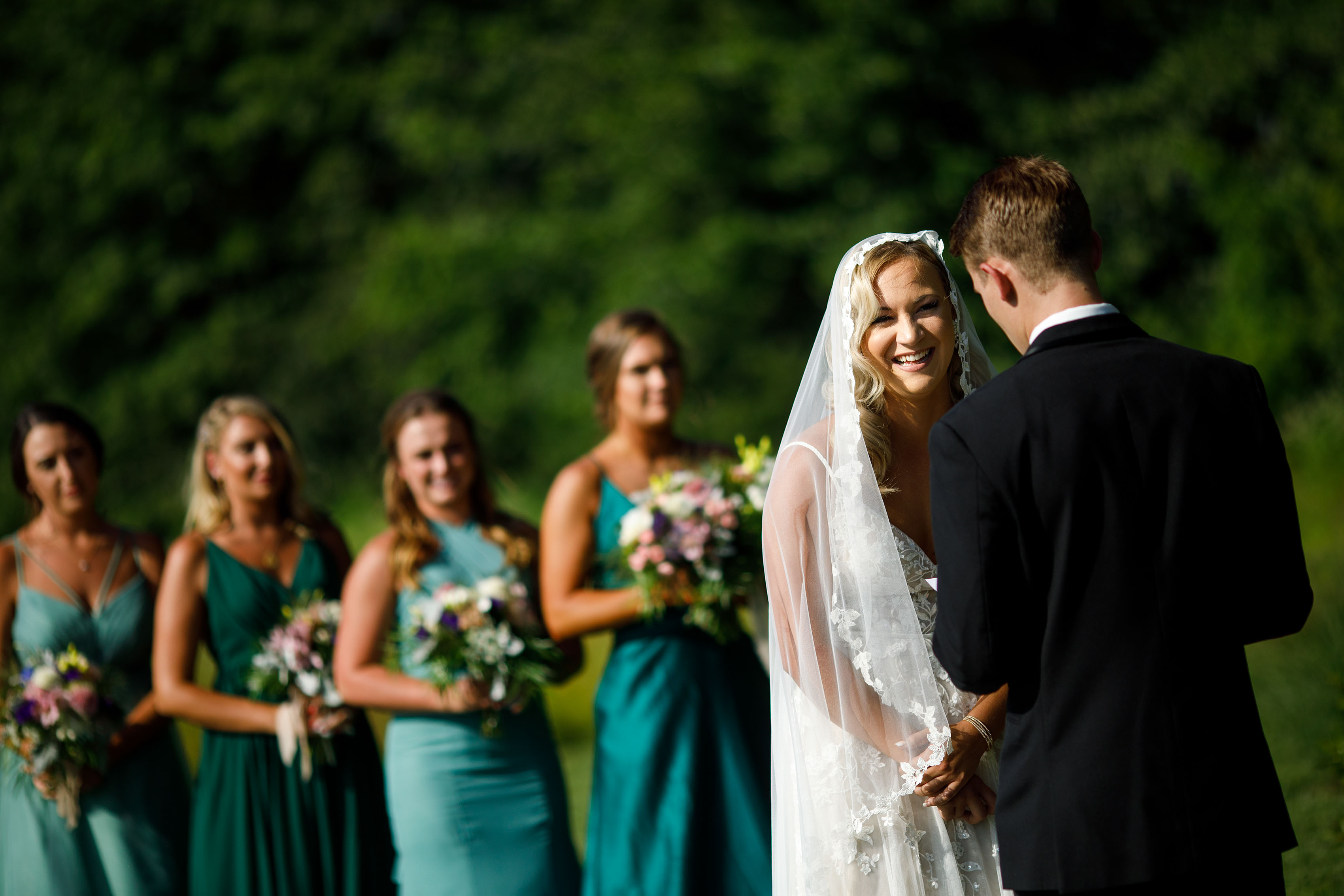 A bride laughs during her Emerson Fields wedding ceremony
