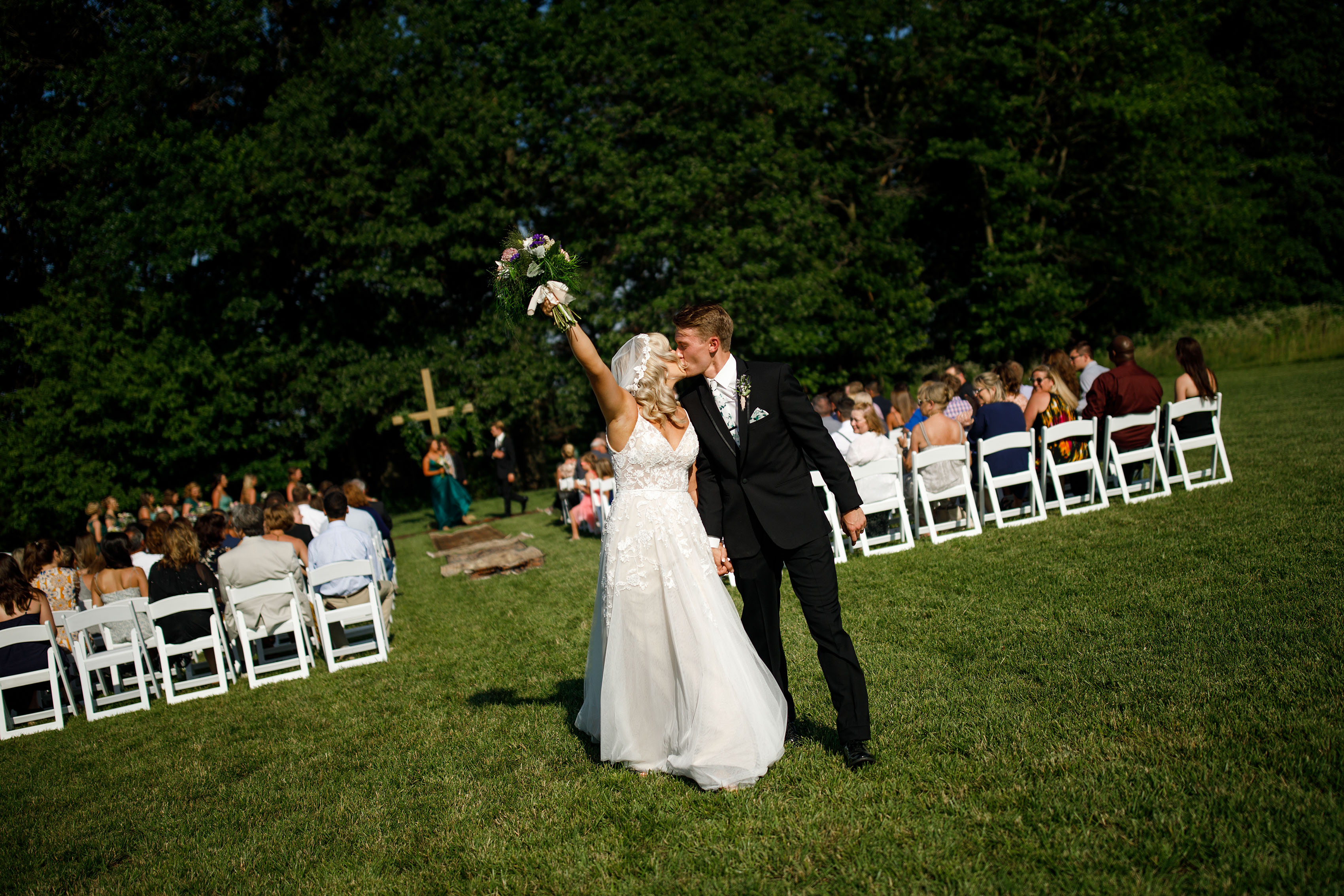 Jacob and Sienna kiss during their wedding in Missouri