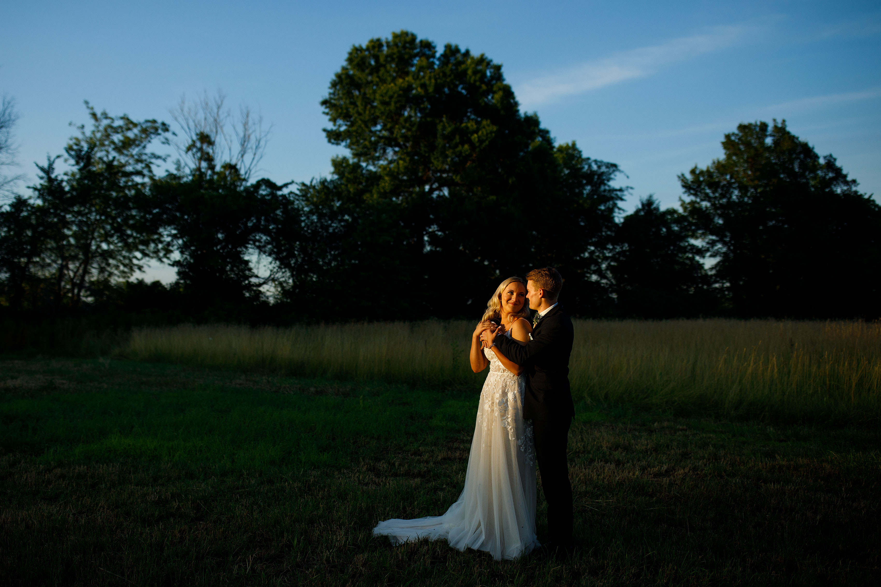 The newlyweds share a moment together during their summer Emerson Fields wedding in Excello, Missouri