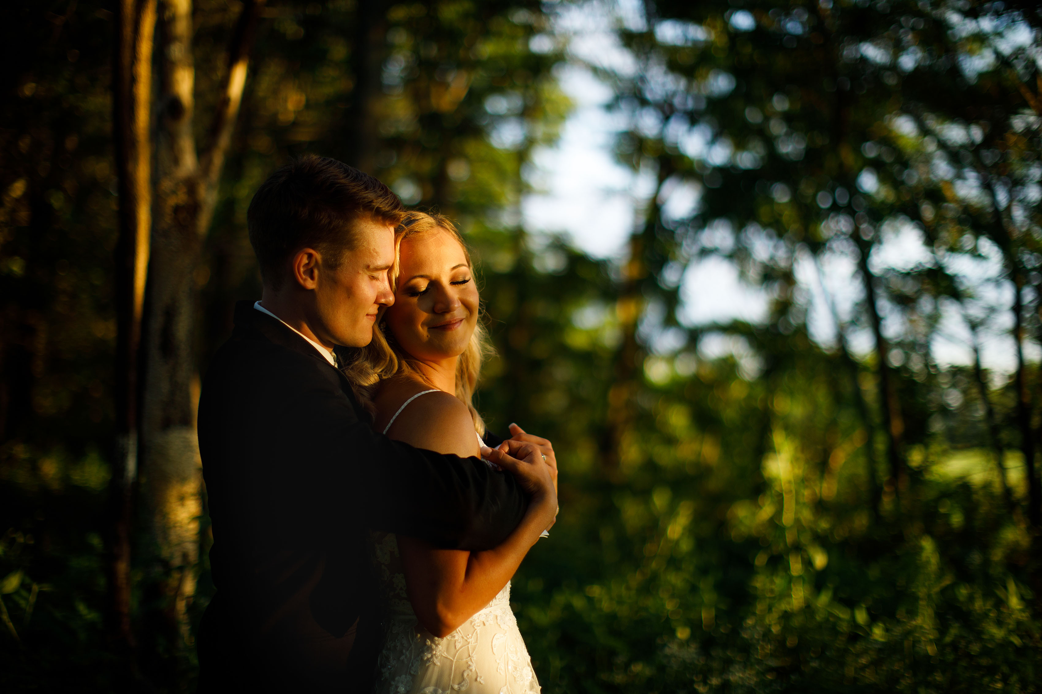 The newlyweds share a moment together in the trees during their Emerson Fields wedding