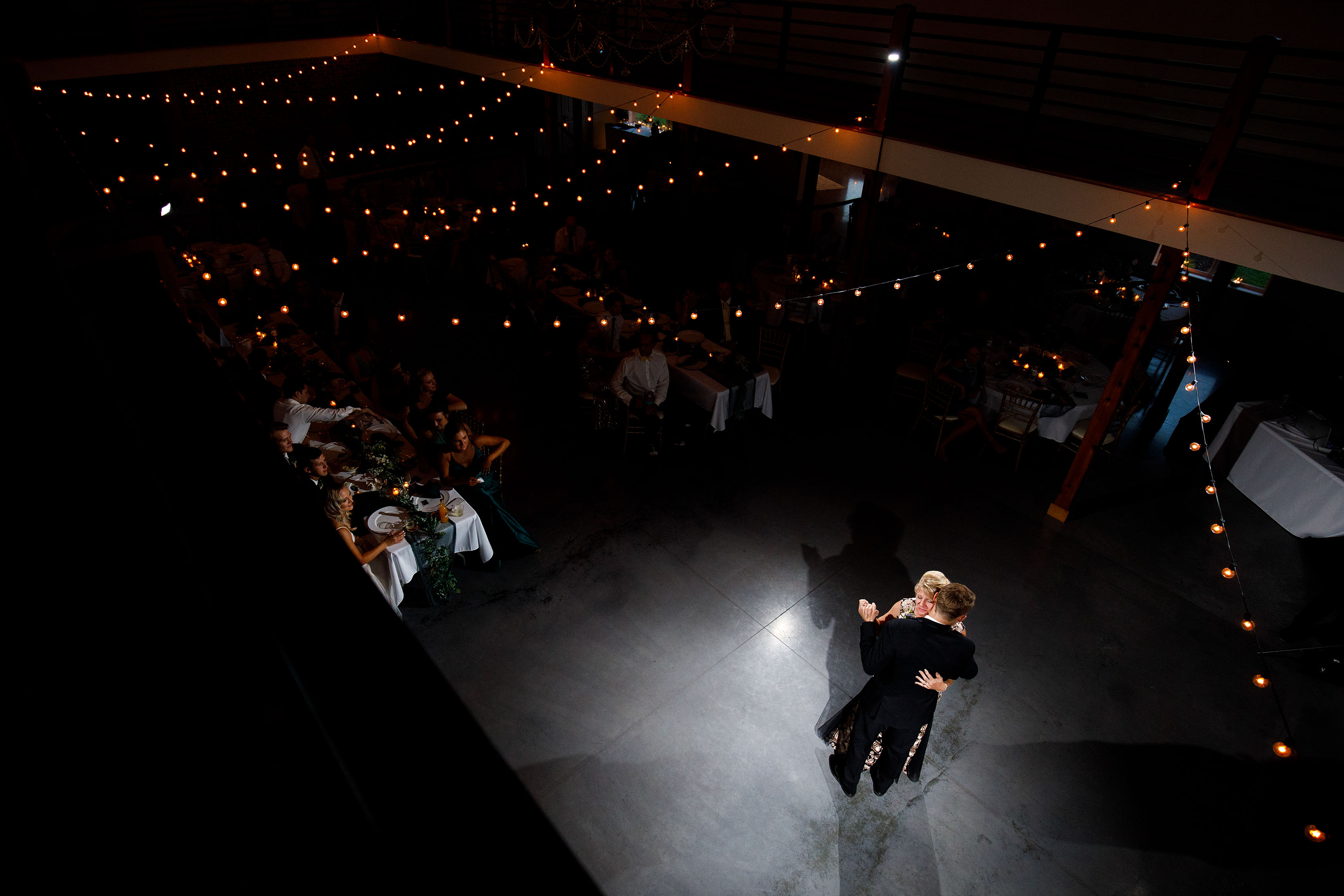The groom and his mother dance at Emerson Fields