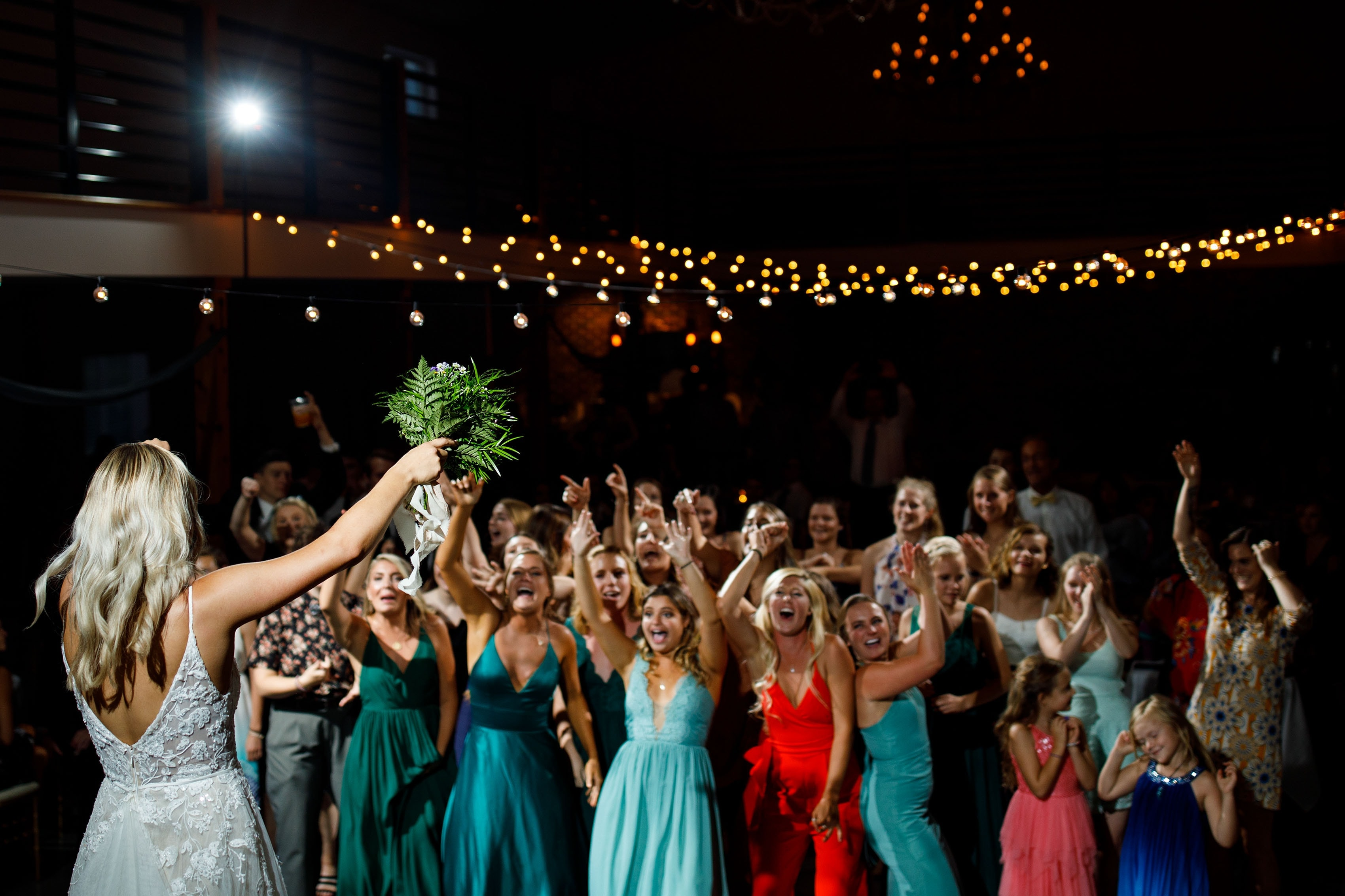 A bride gets her friends excited before throwing the boquet