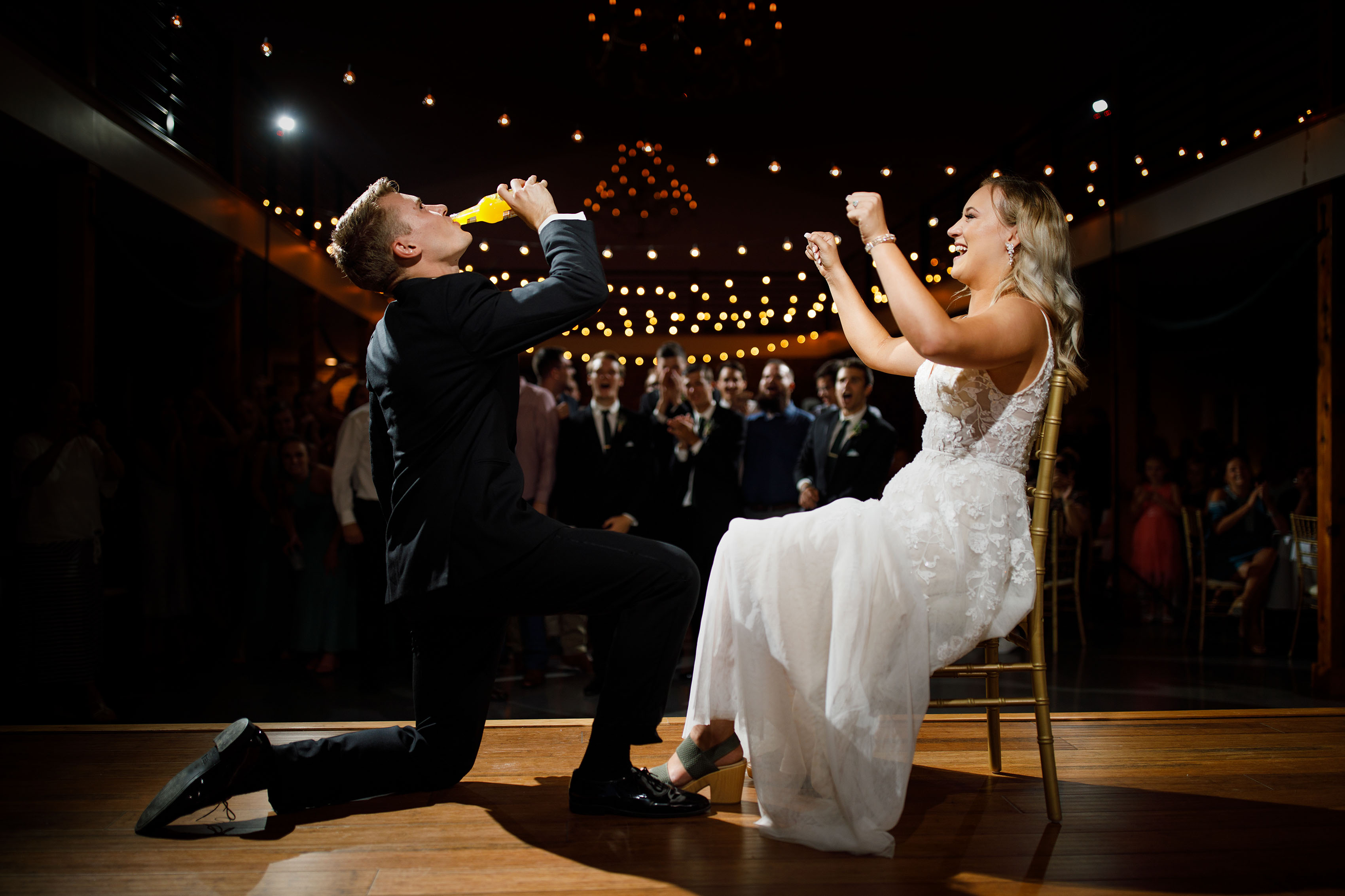 The groom gets iced by the bride during their wedding