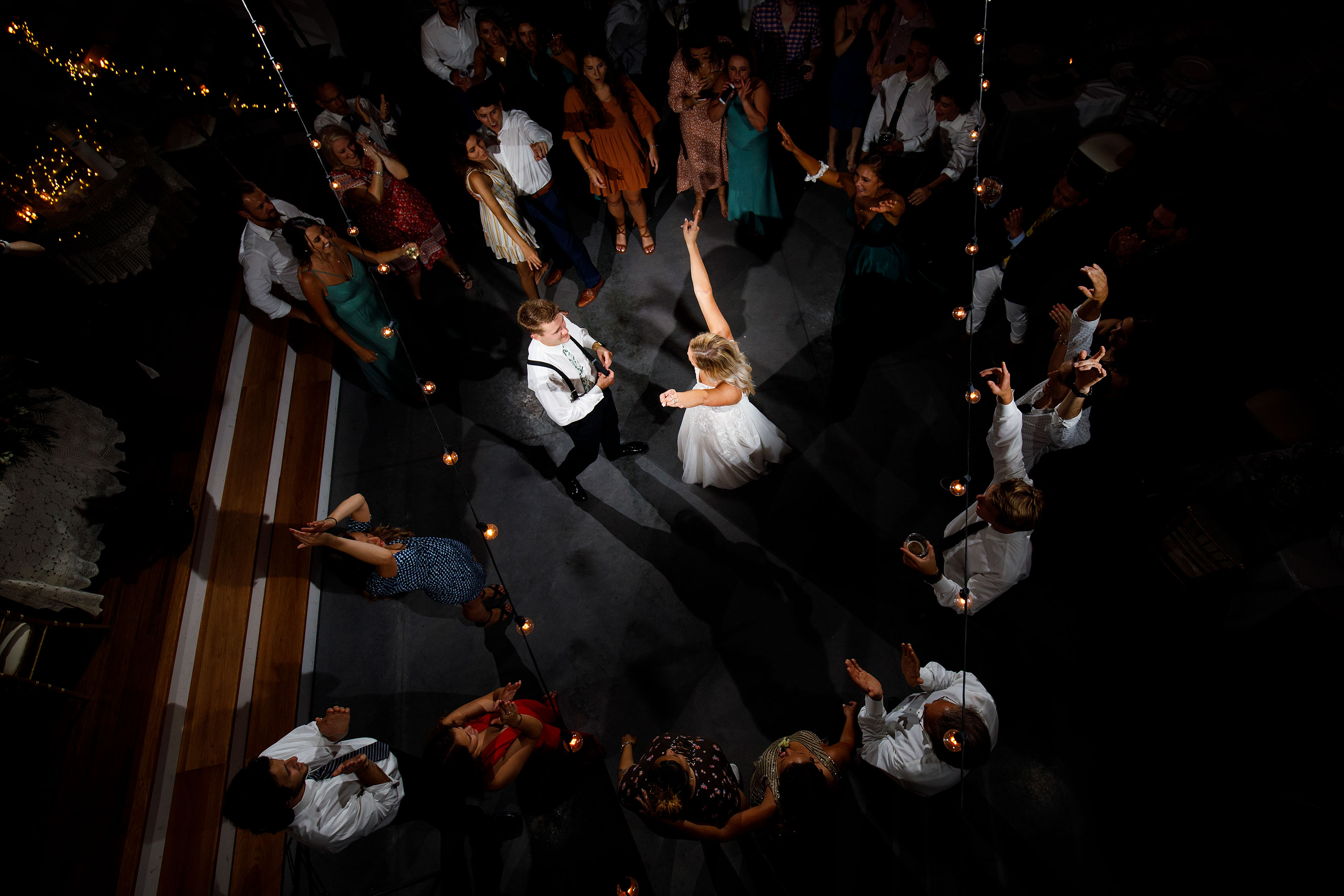 Guests dance around the bride and groom during a wedding at Emerson Fields in Excello, Missouri