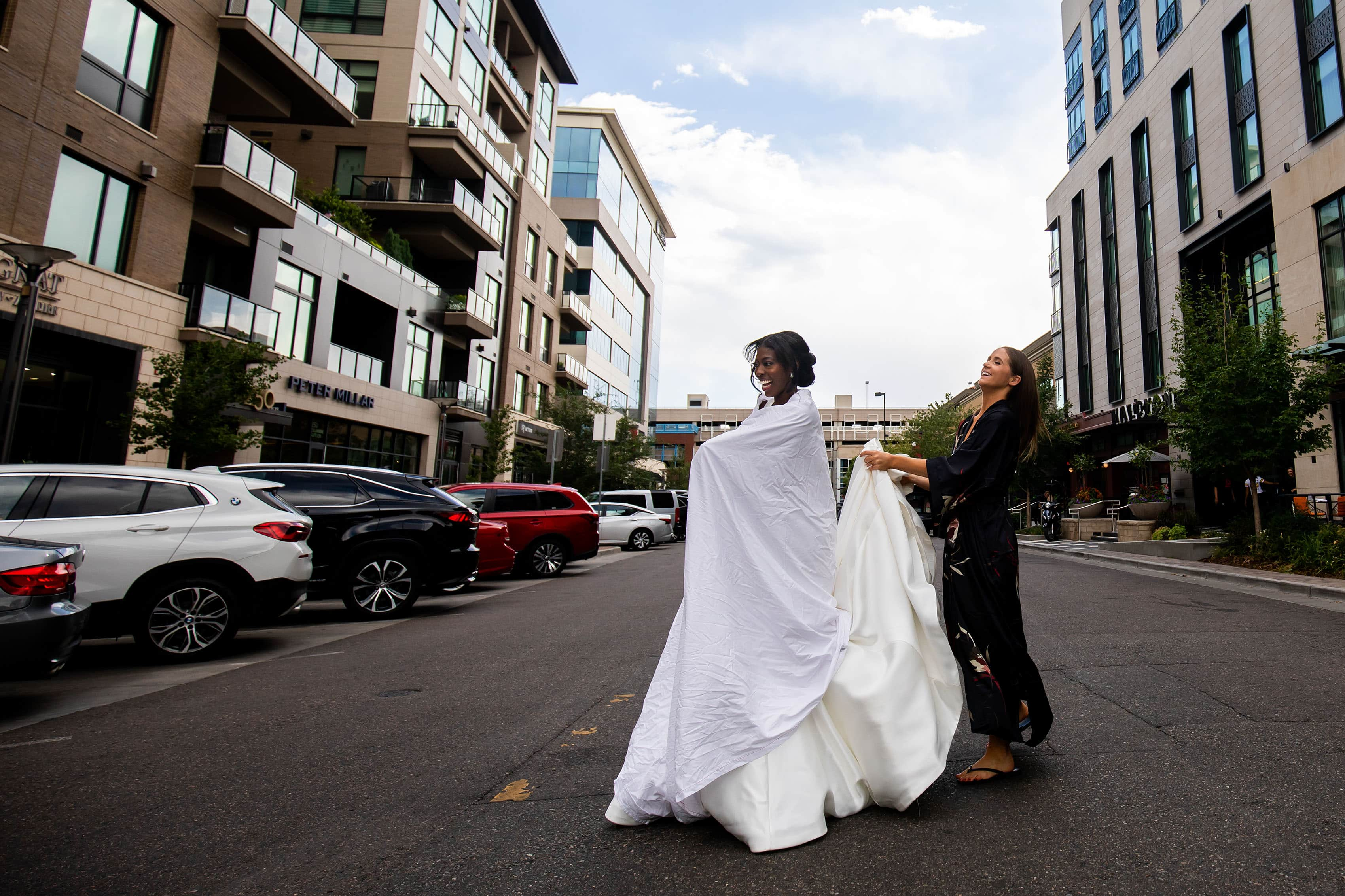 Bride crosses the street in Cherry Creek North