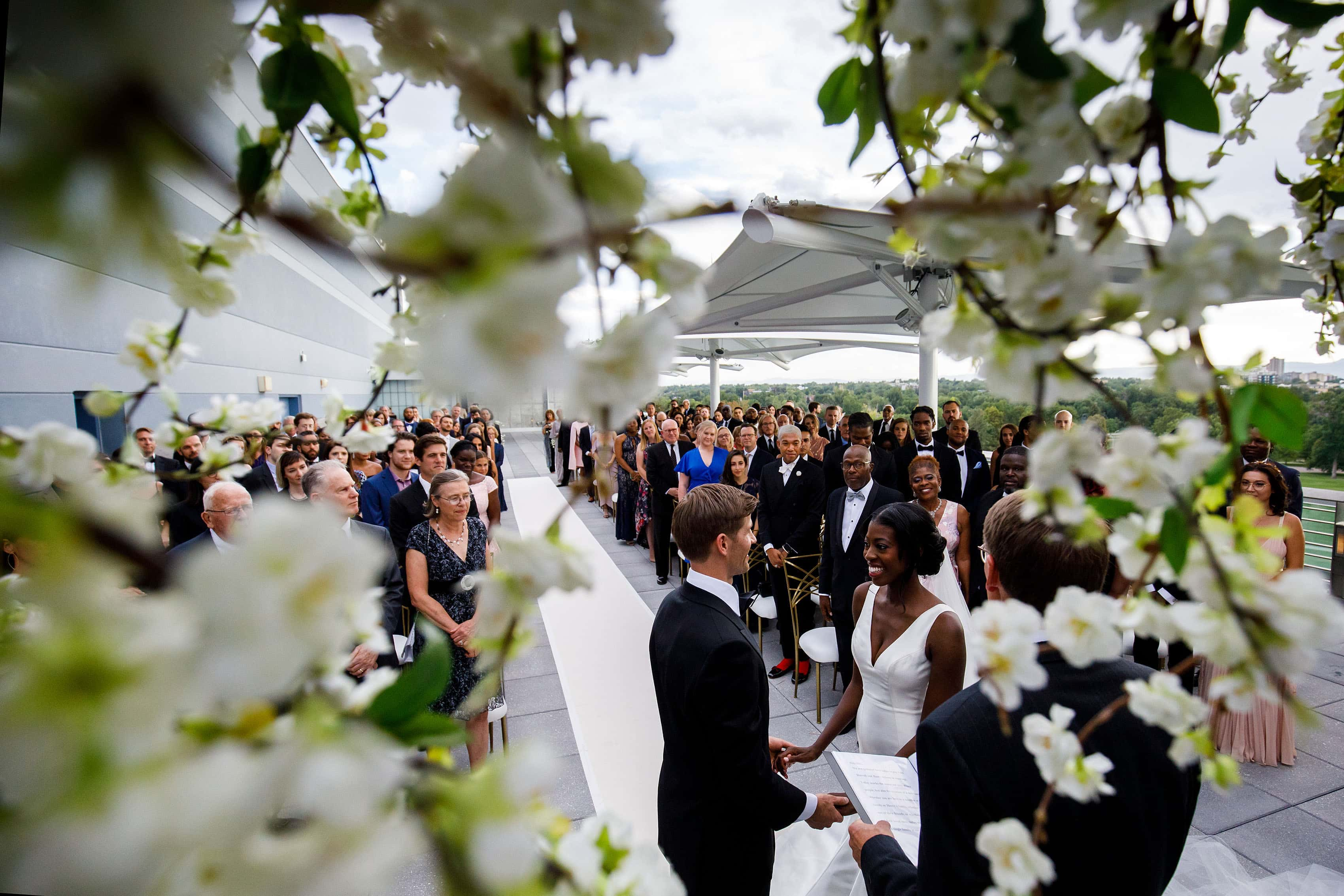 Rooftop wedding ceremony at the Denver Museum of Nature and Science