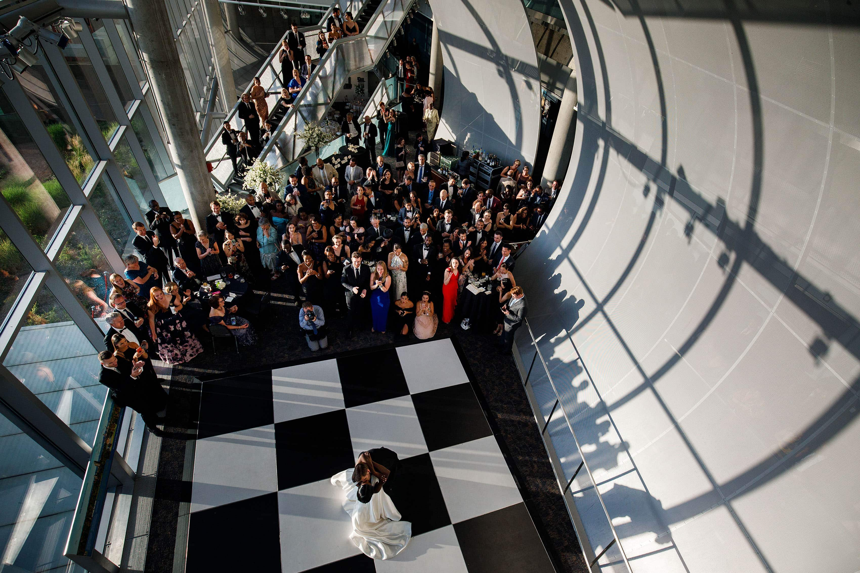 Newlyweds share their first dance in the Denver Museum of Nature and Science