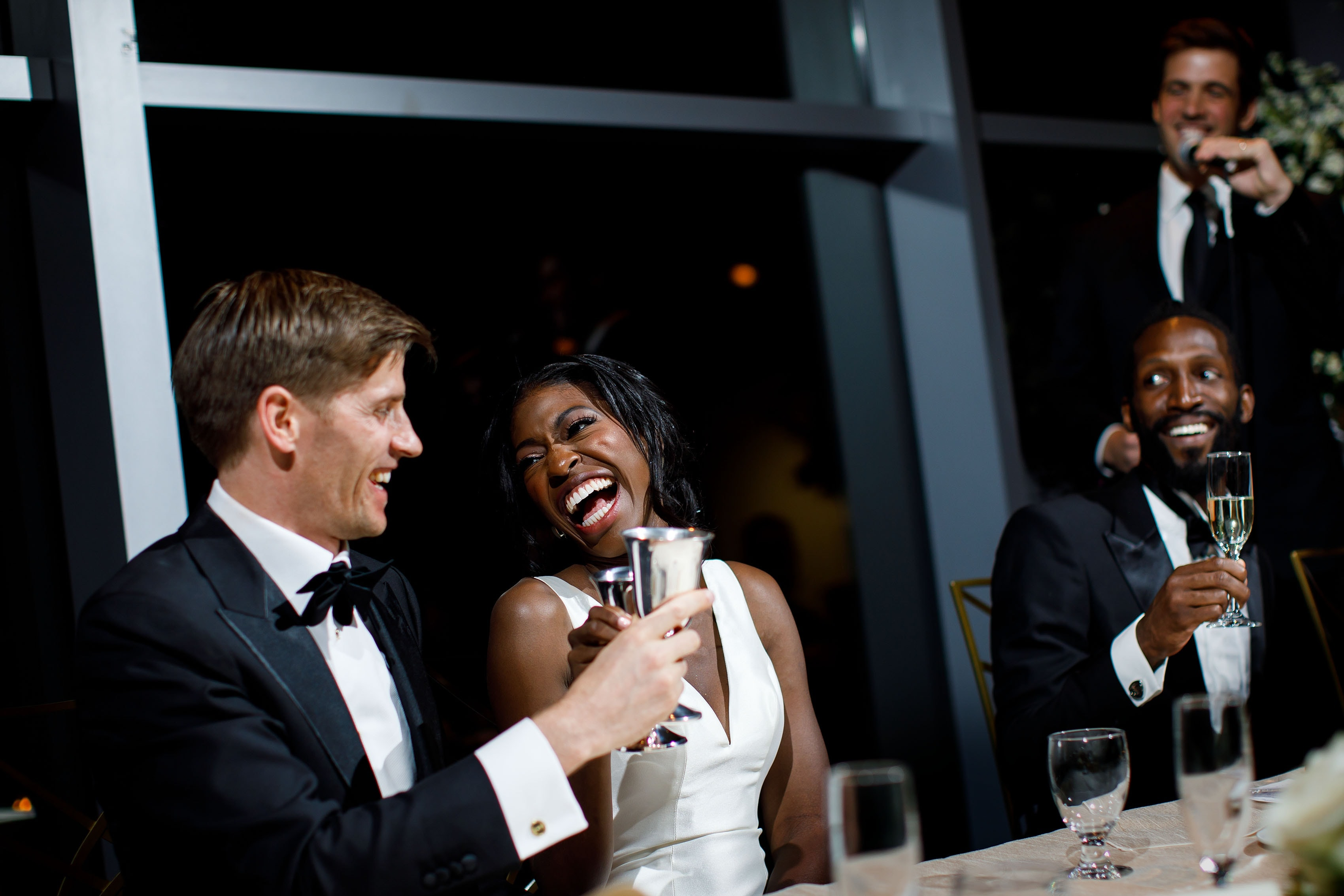 The bride and groom share a laugh at the Denver Museum of Nature and Science