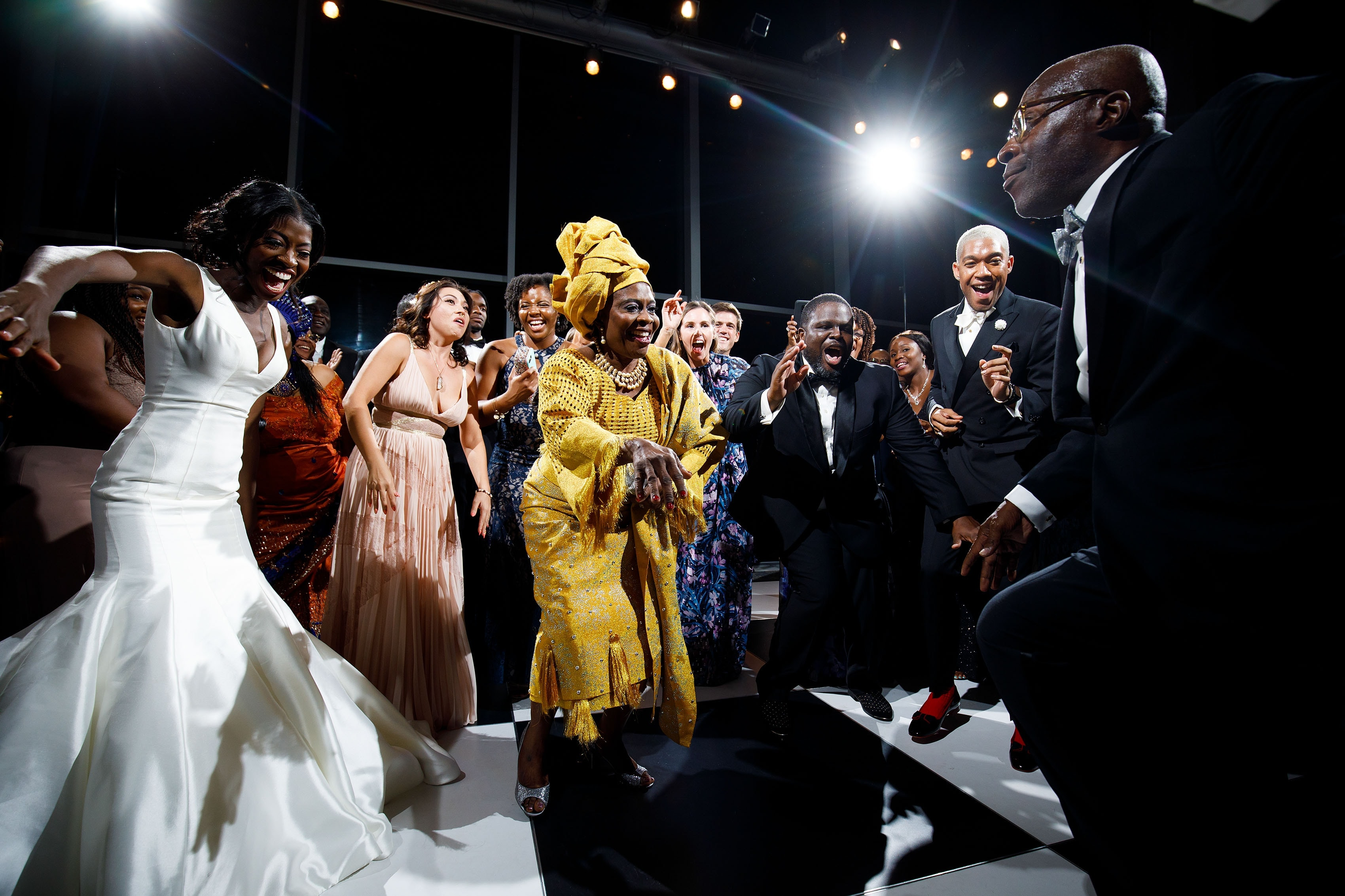 Guests dance during a wedding in the grand atrium at the Denver Museum of Nature and Science
