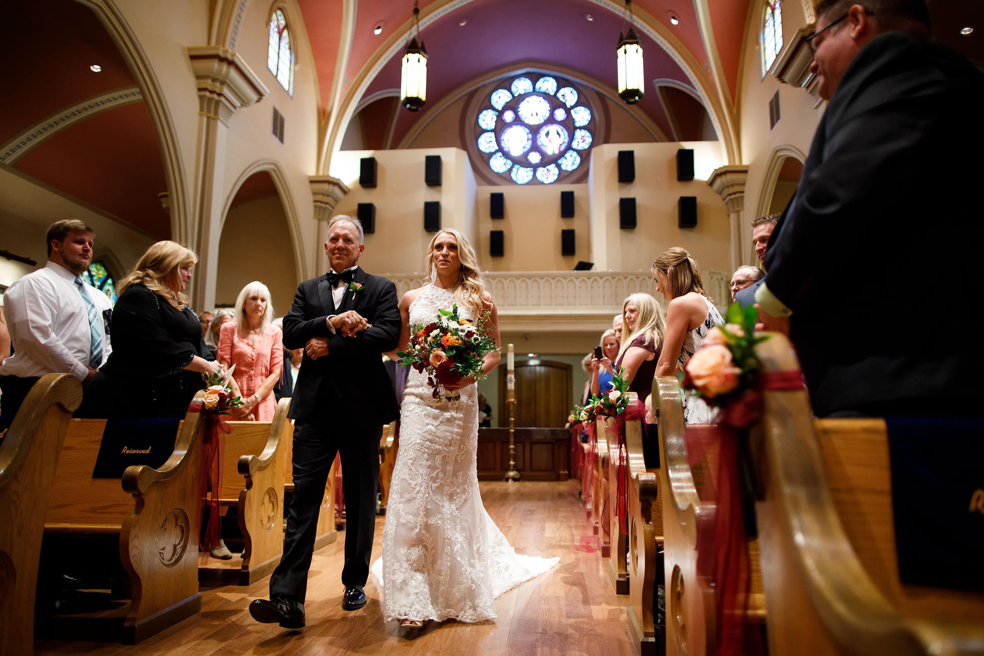 Bride walks down the aisle at St. Mary's Cathedral in Colorado Springs