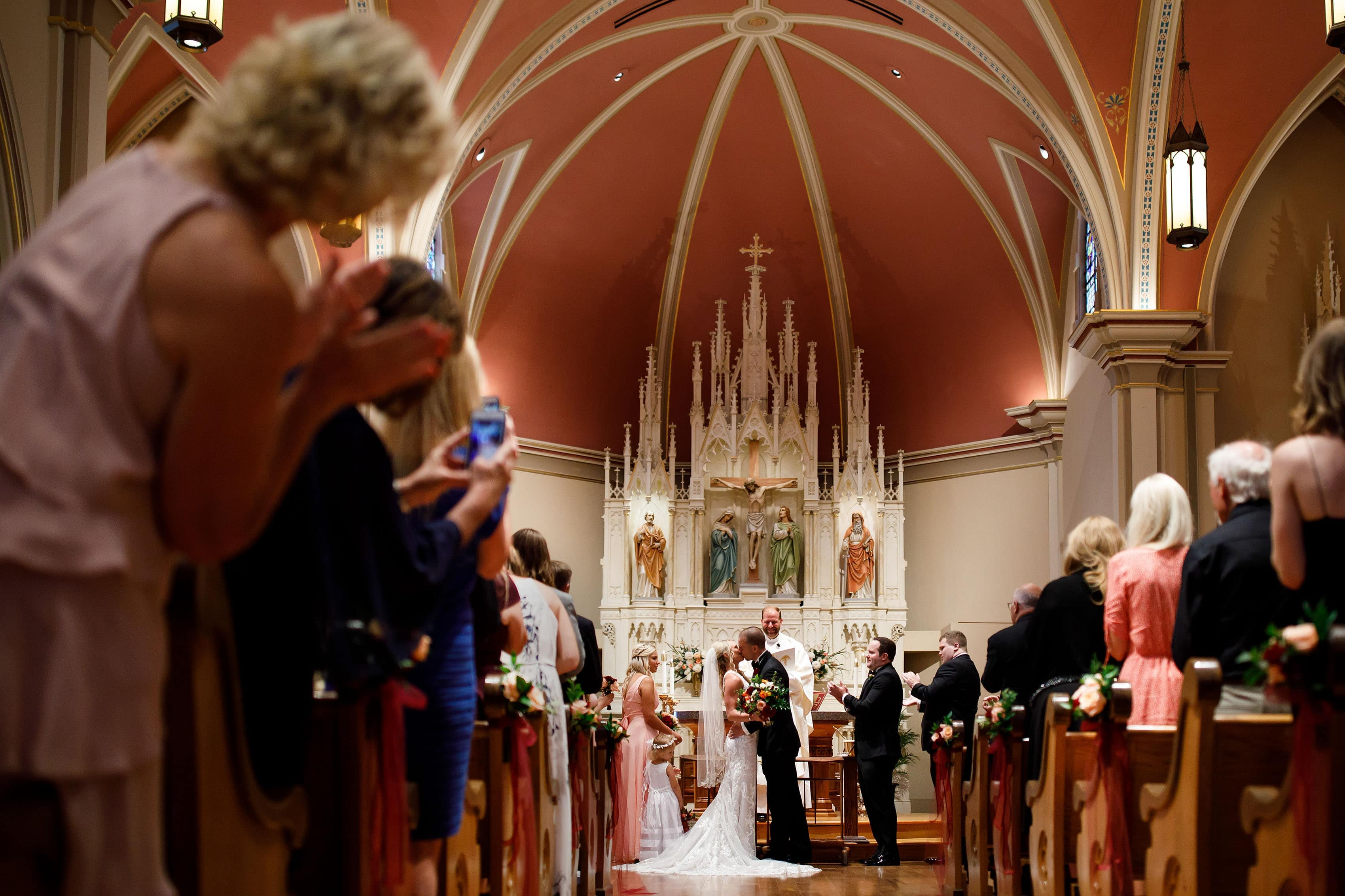 A couple kisses during their wedding at St. Mary's Cathedral in Colorado Springs