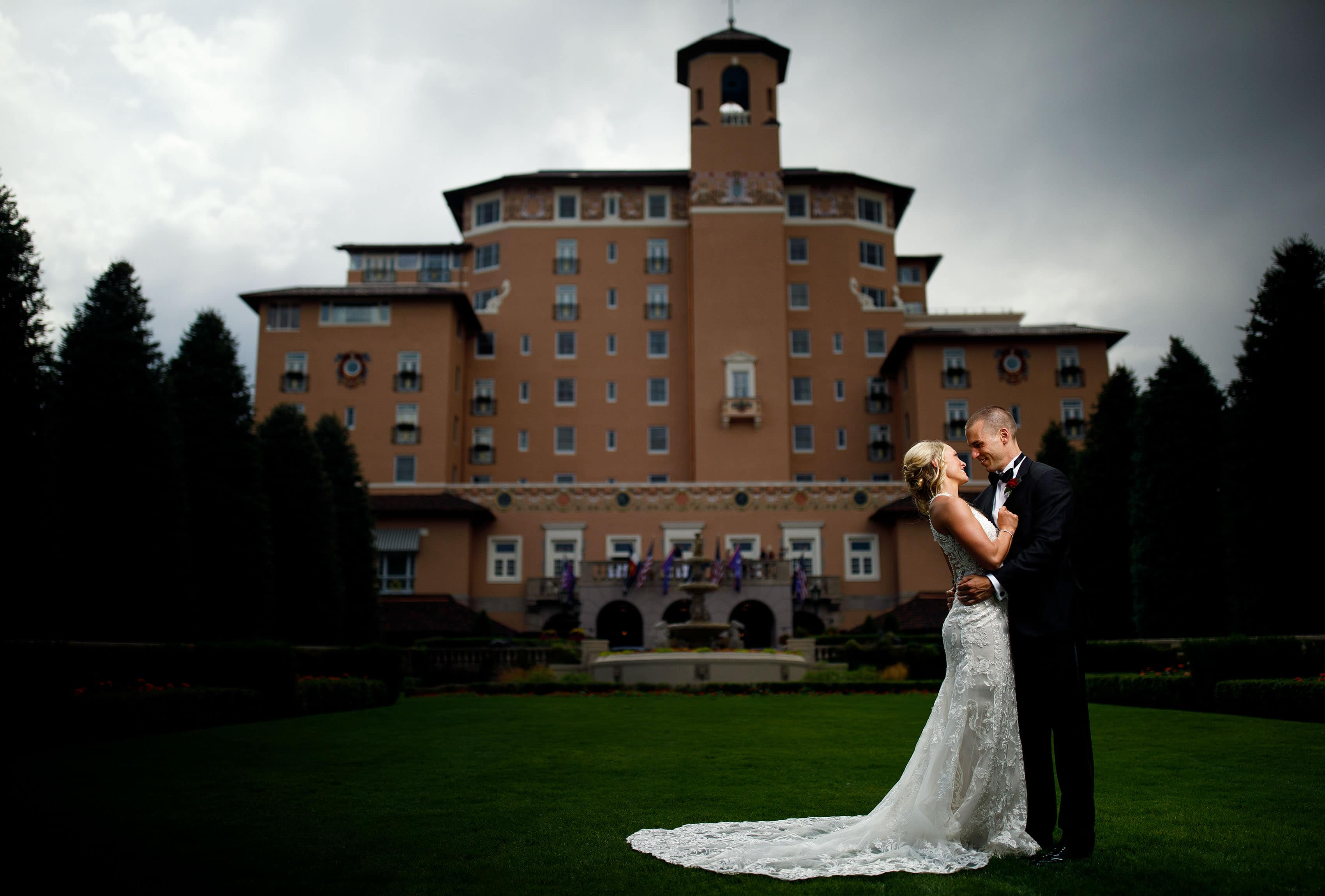A couple pose at The Broadmoor on their wedding day