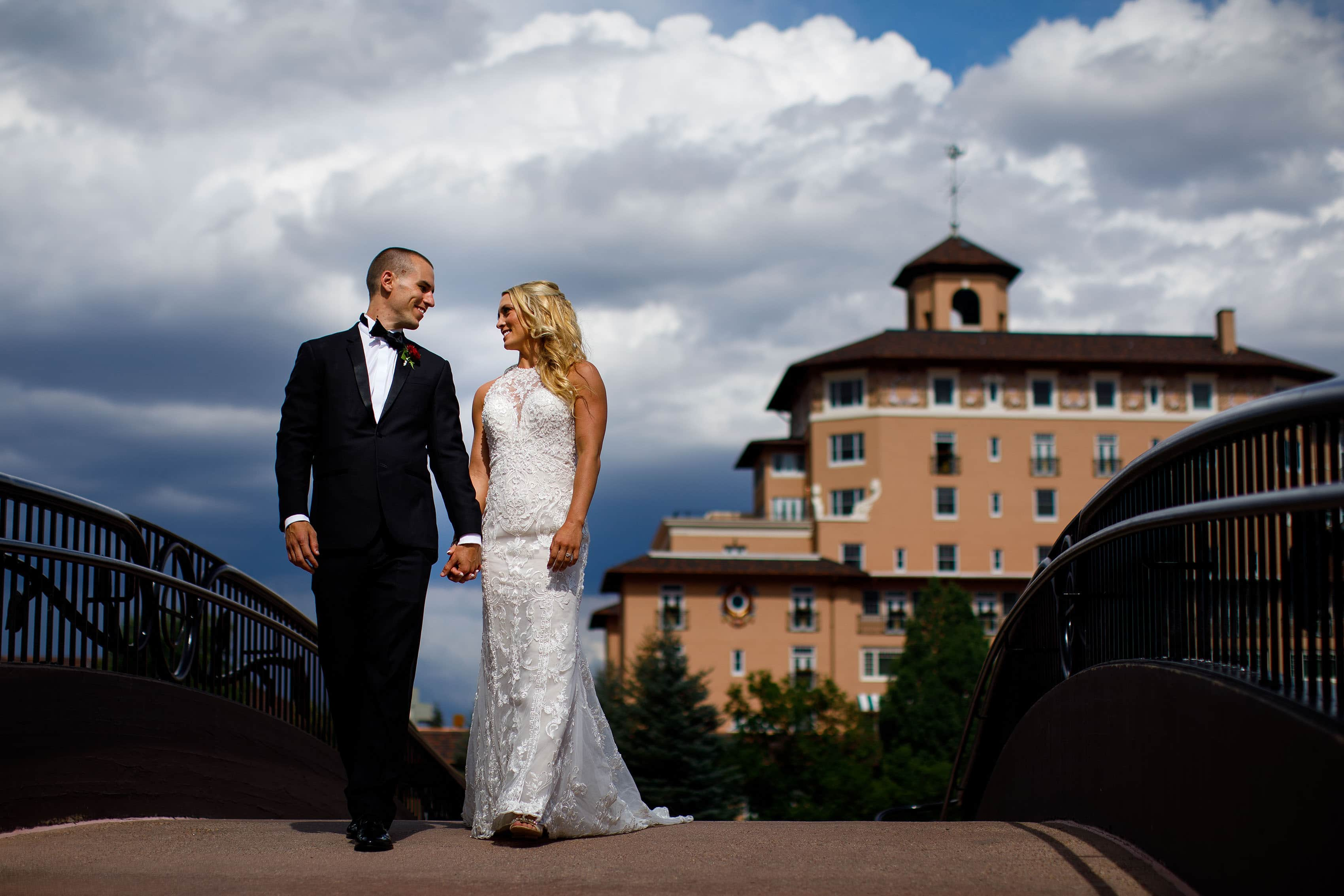 Kinsey and Sam walk together on the bridge at The Broadmoor near Cheyenne Lake