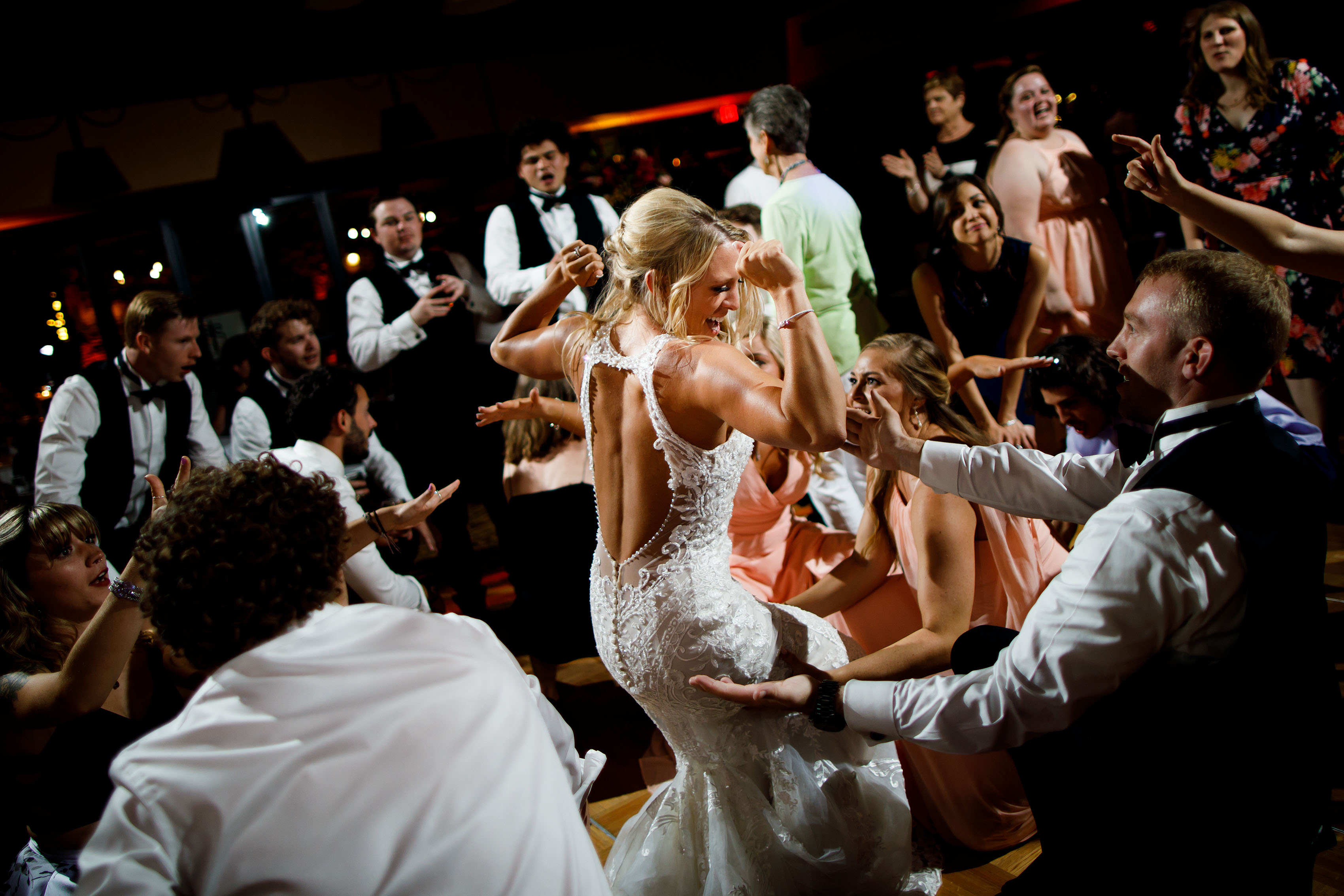 The bride dances with guests at Cheyenne Lodge