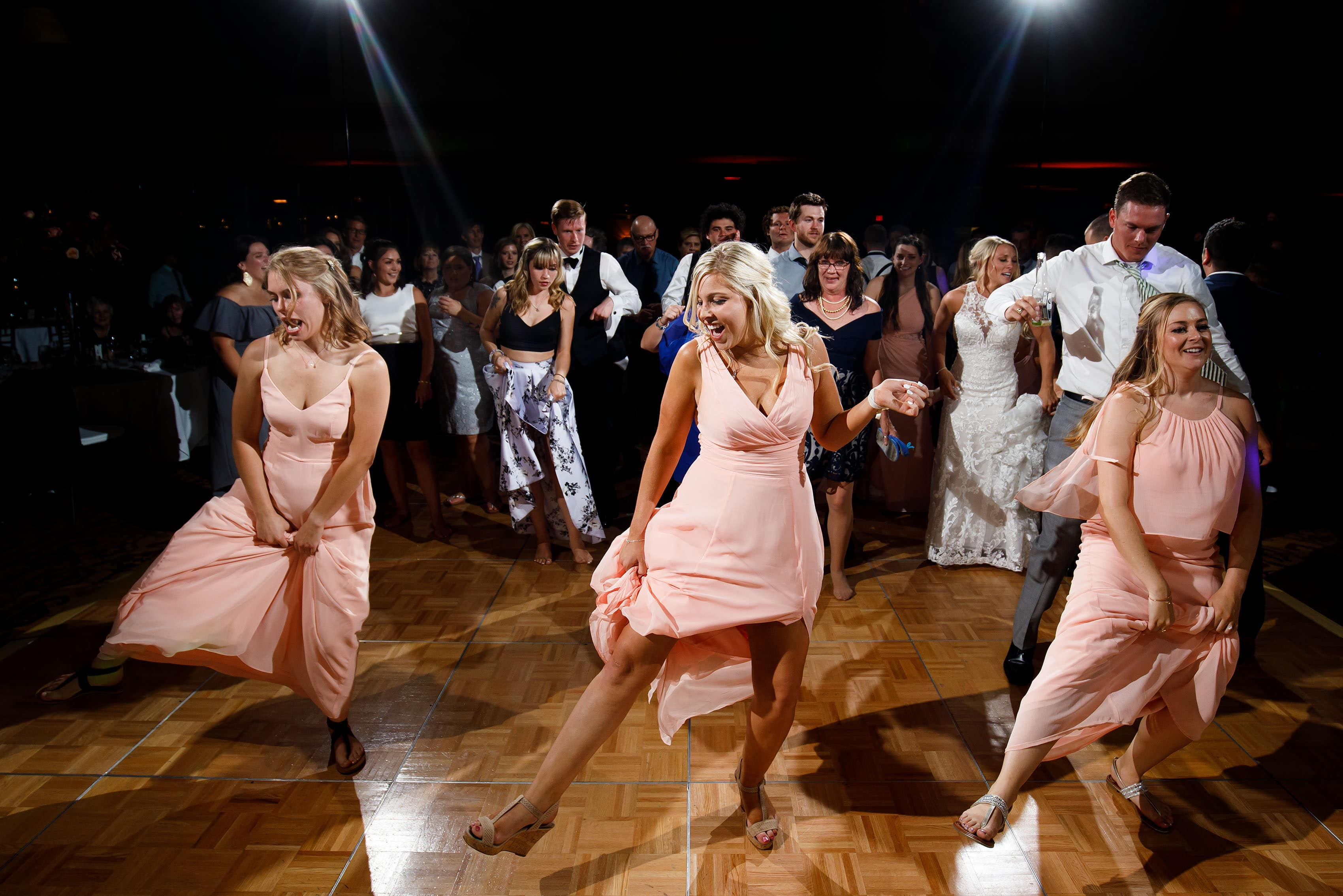 Bridesmaids lead a line dance during a wedding reception at Cheyenne Lodge