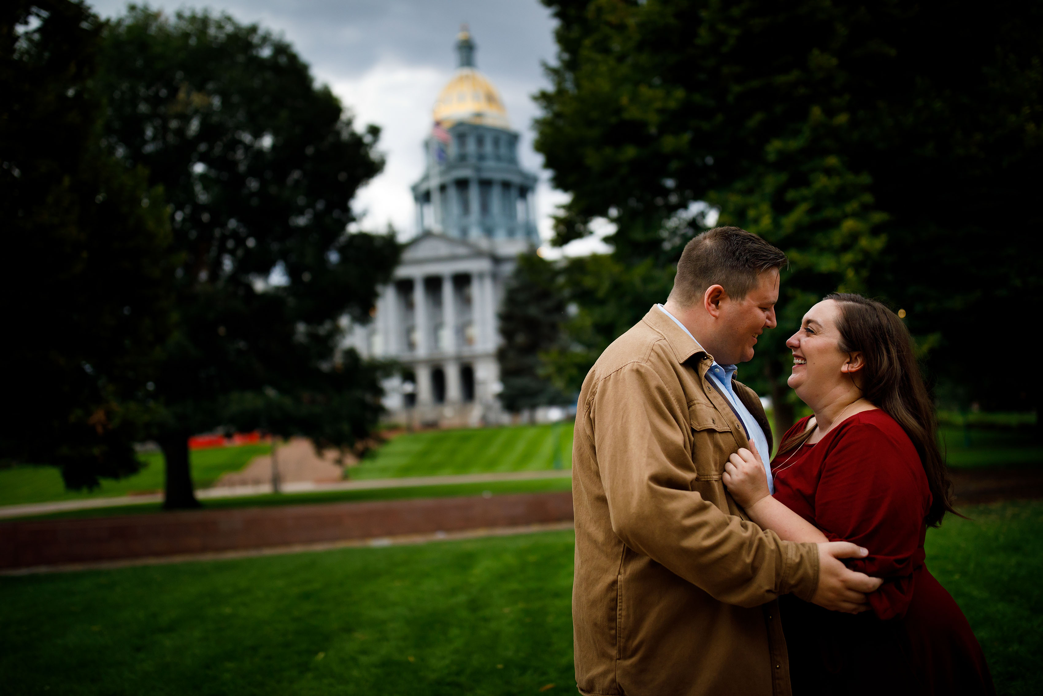 Matt and Katie share a moment during their engagement near the Colorado State Capitol
