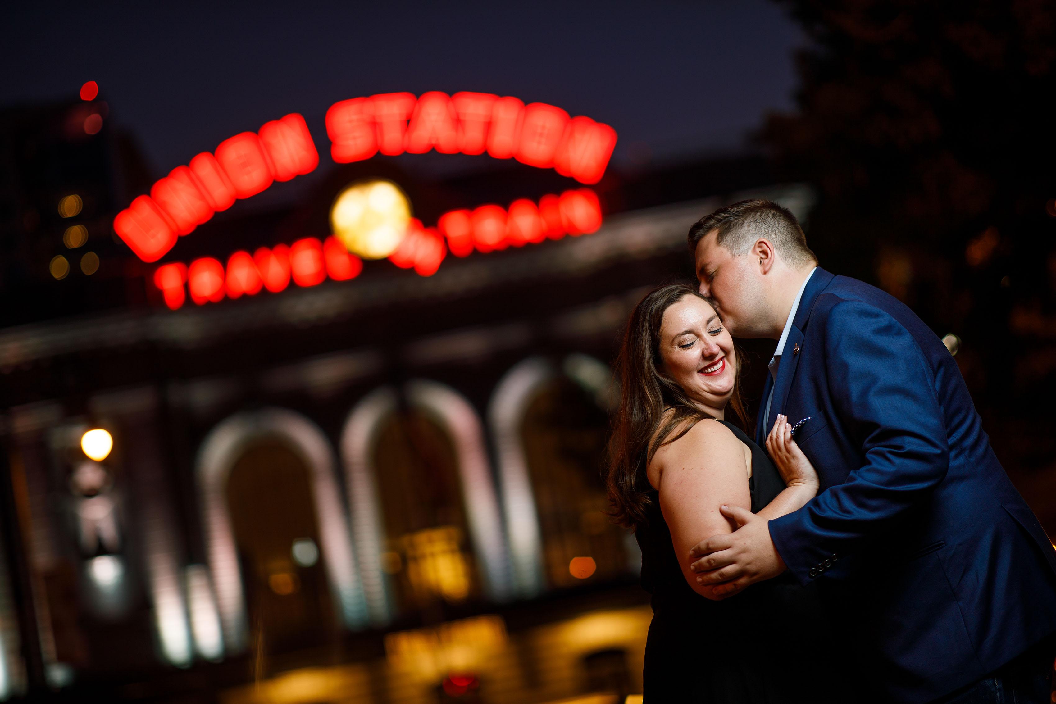 Matt kisses Katie in front of Denver Union Station