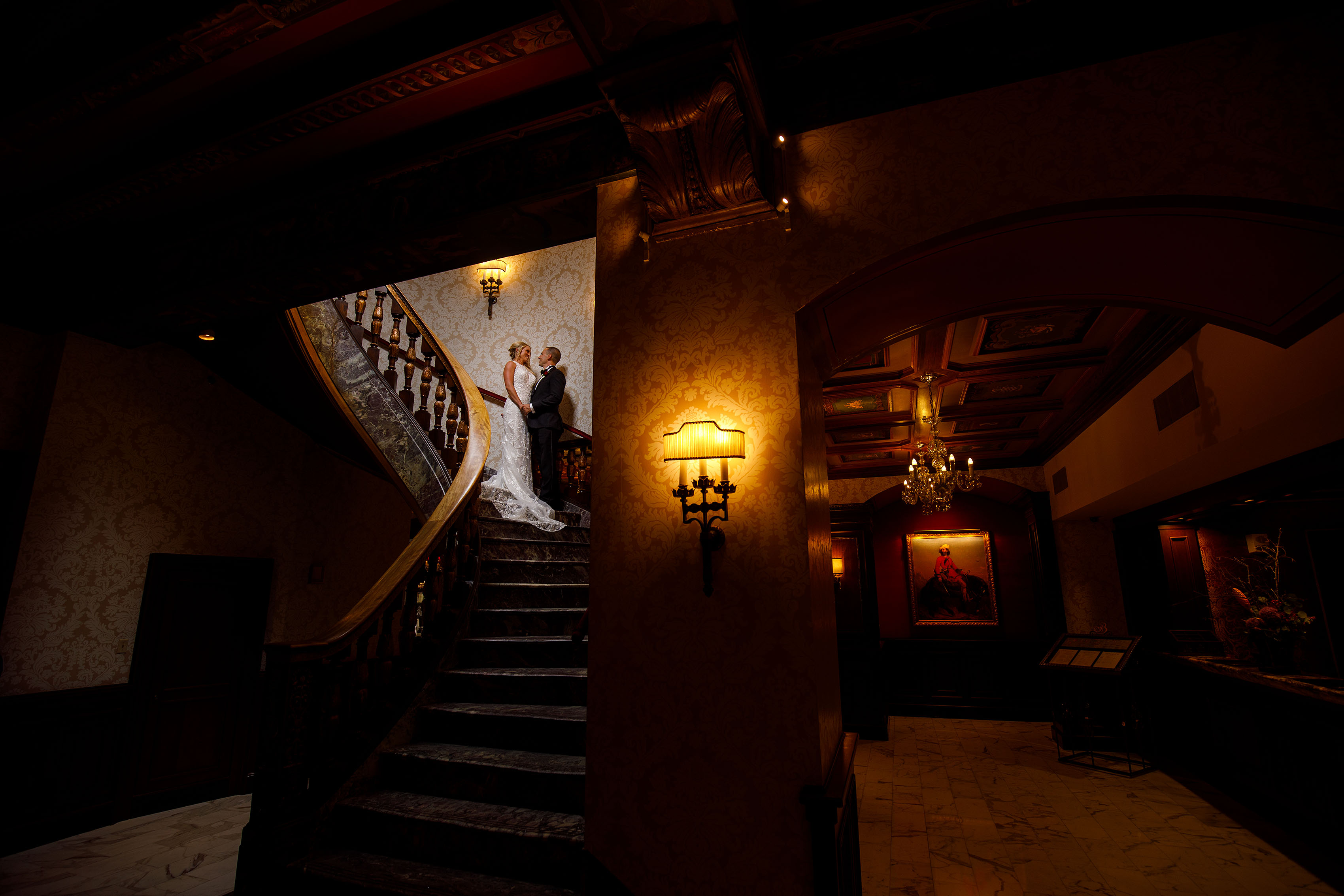 Bride and groom pose in a stairwell at The Broadmoor